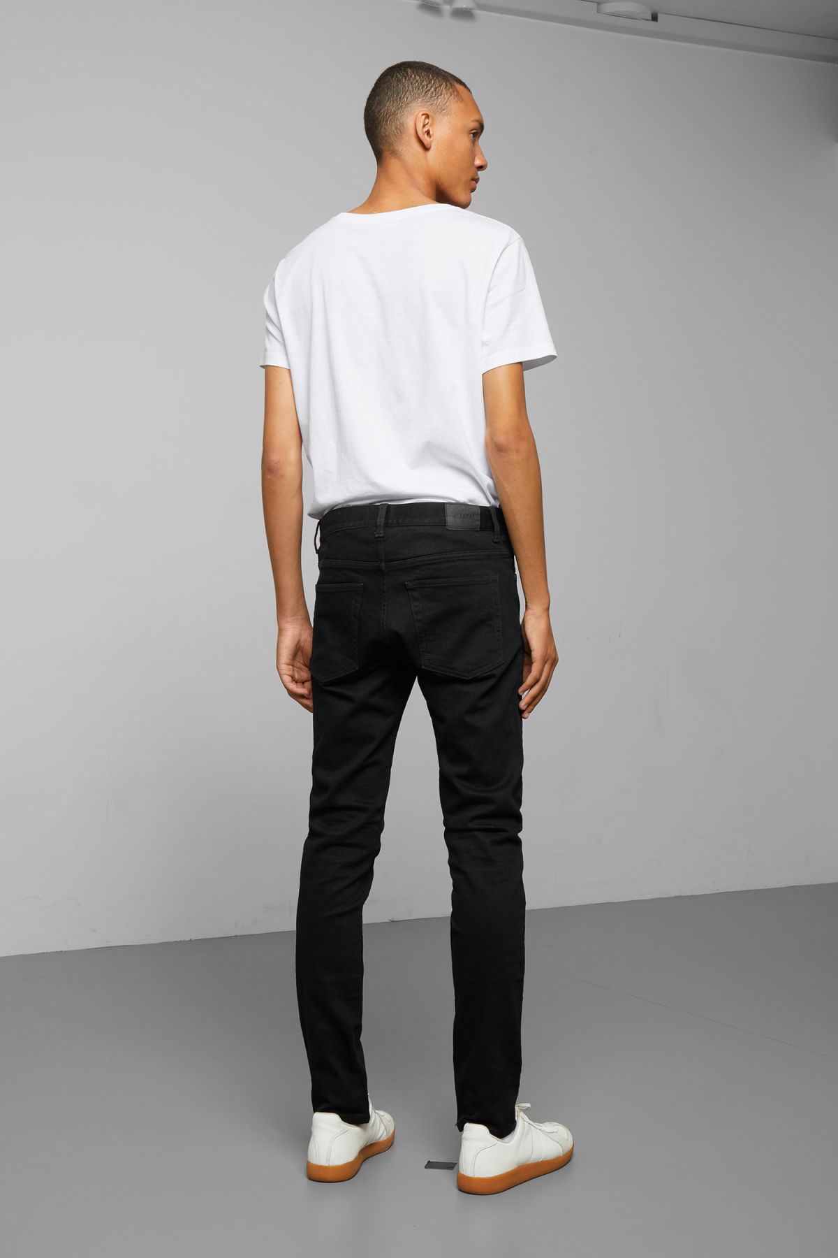 Model side image of Weekday friday black jeans in black