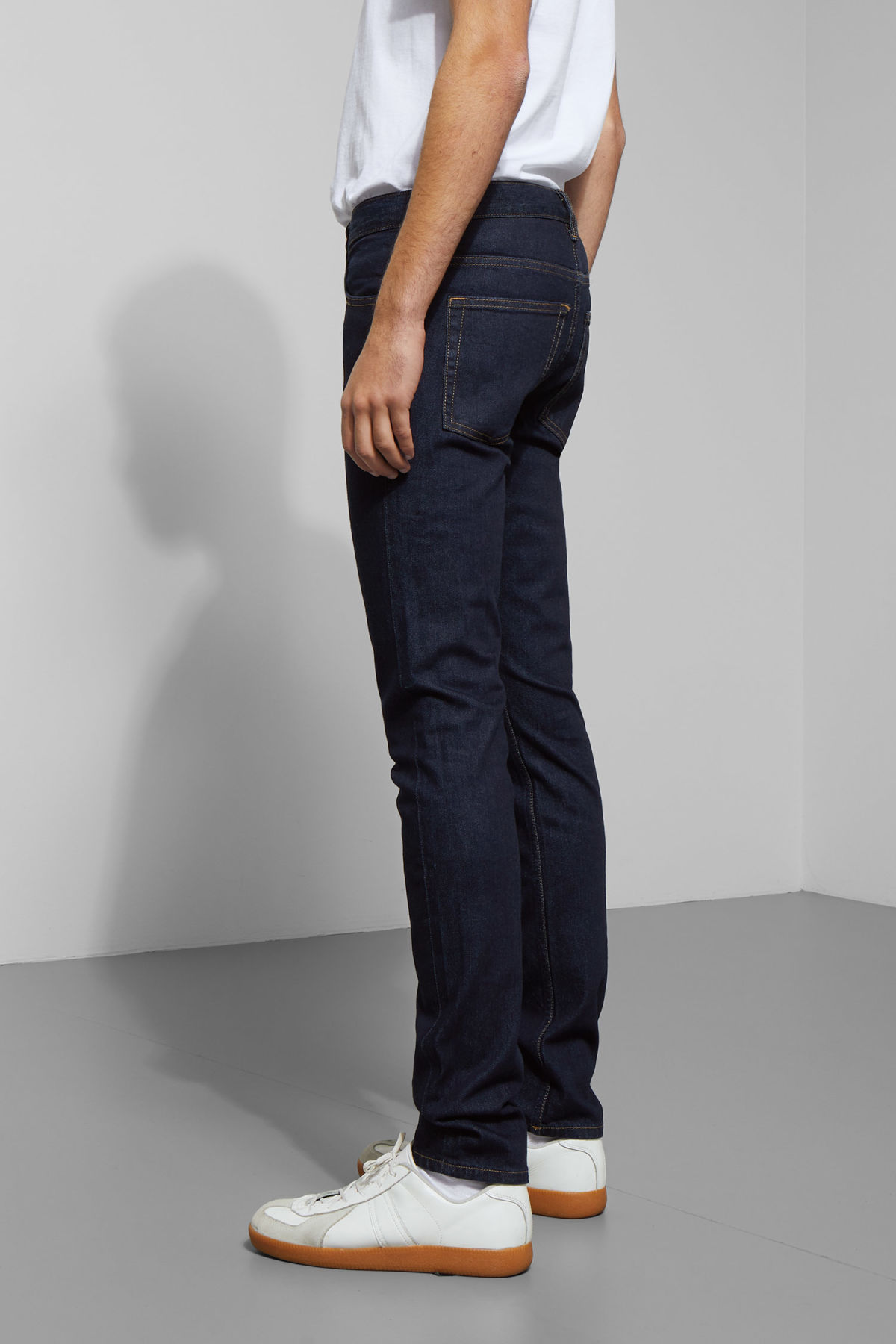 Model side image of Weekday friday dark rinse jeans in blue