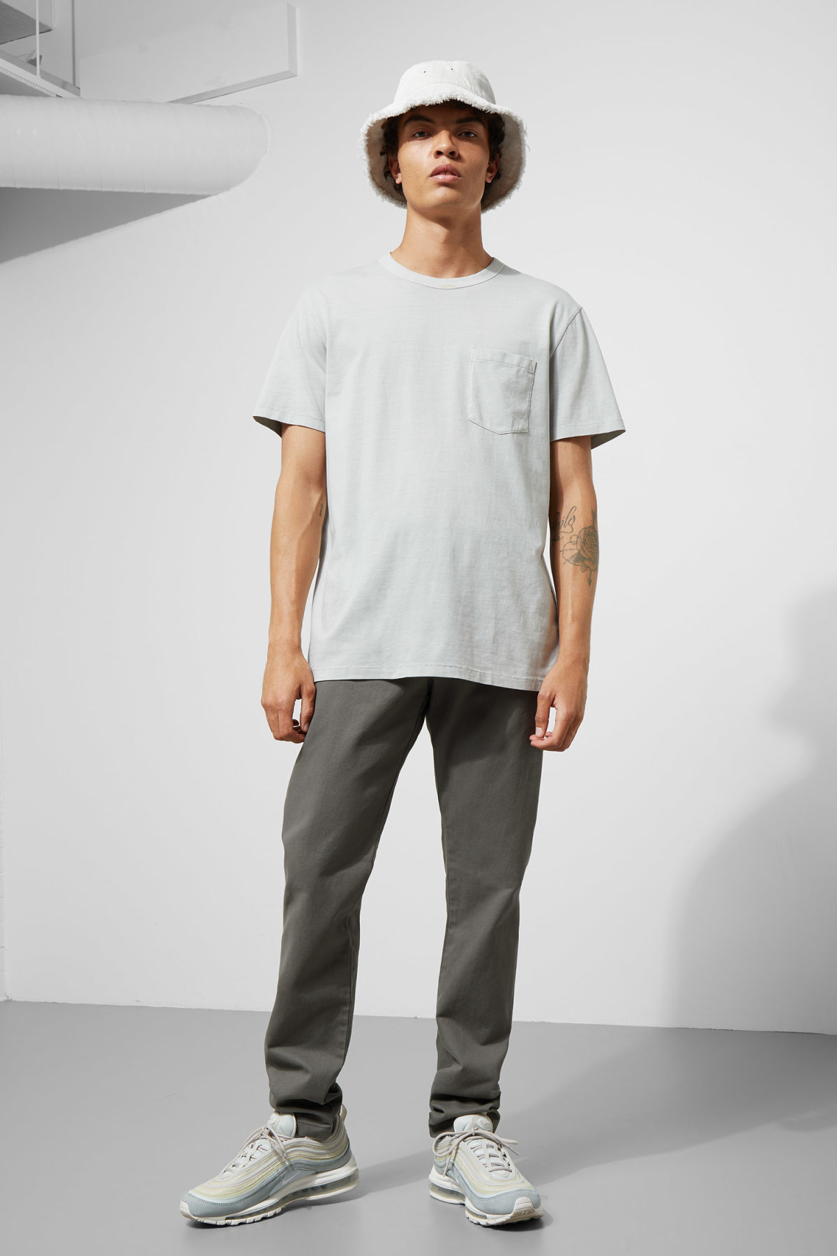 Model front image of Weekday wood chinos in grey
