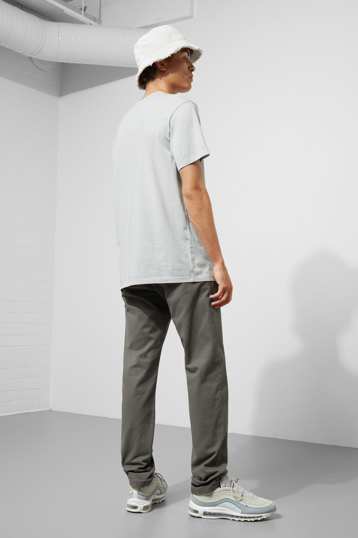 Model side image of Weekday wood chinos in grey