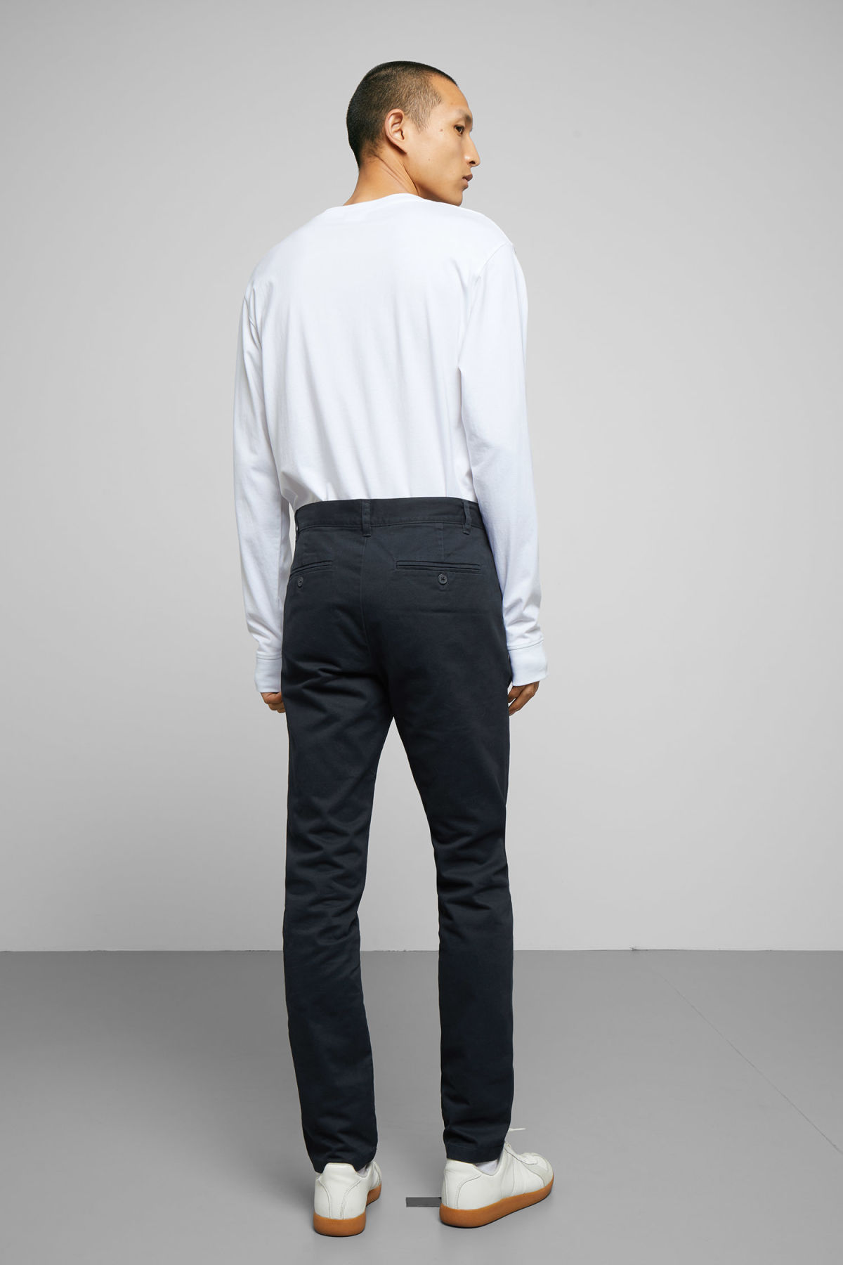 Model side image of Weekday wood chinos in blue