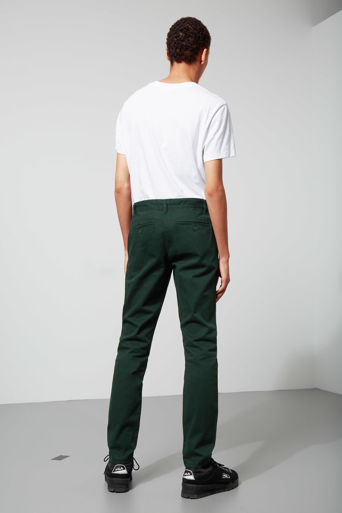 Model side image of Weekday wood chinos in green
