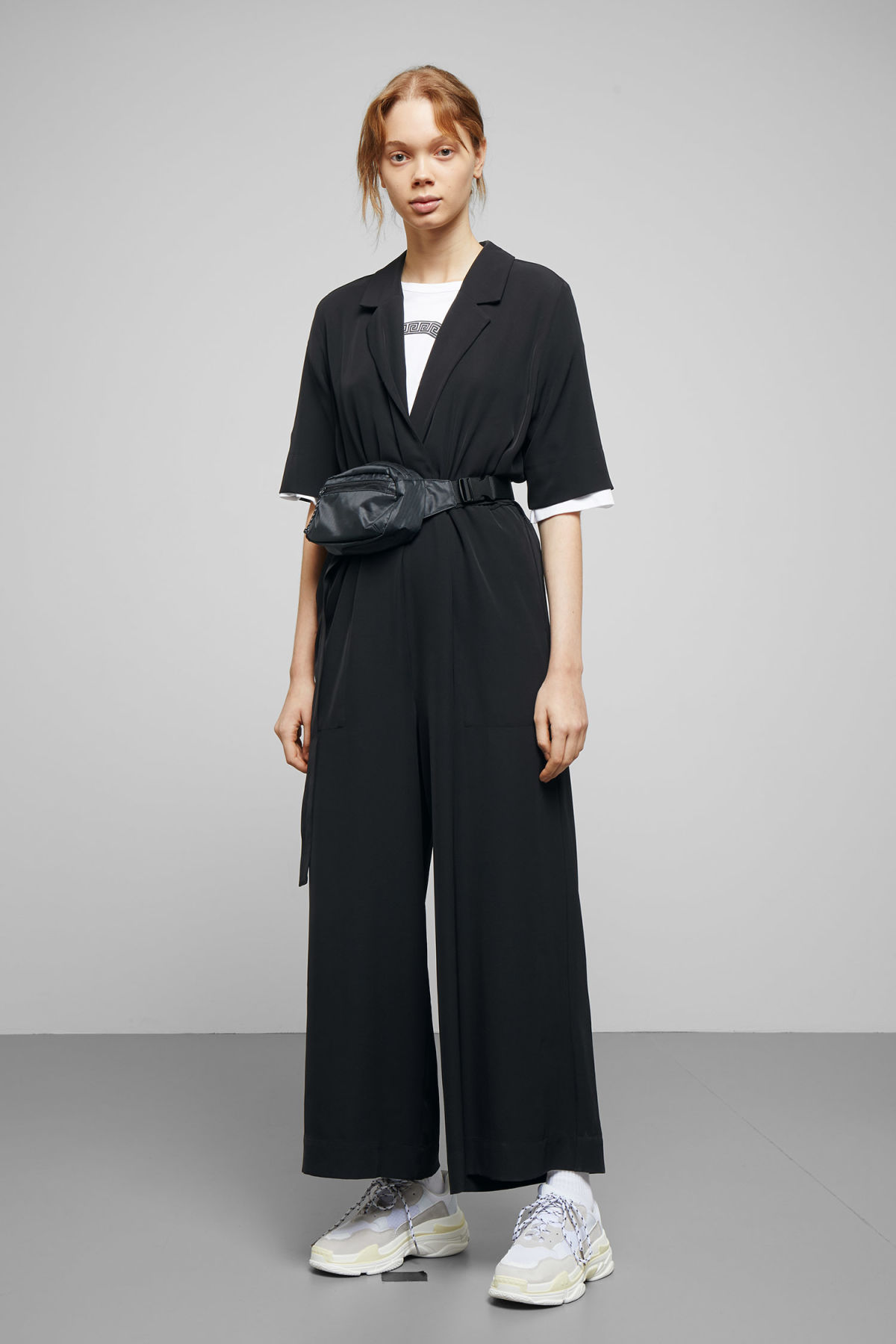 Model front image of Weekday jimi short sleeve jumpsuit in black