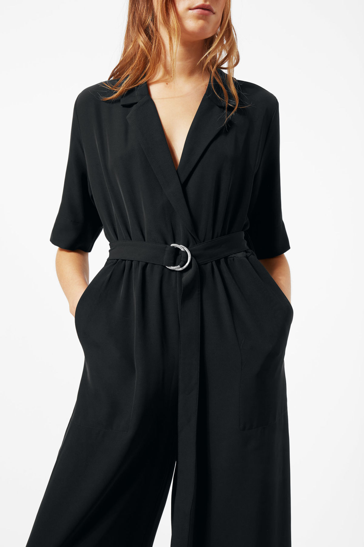 Model side image of Weekday jimi short sleeve jumpsuit in black