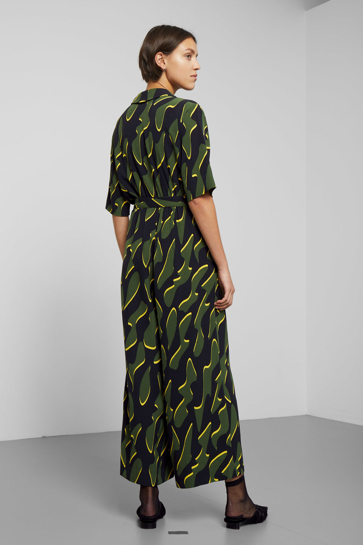 Model side image of Weekday jimi short sleeve jumpsuit in green