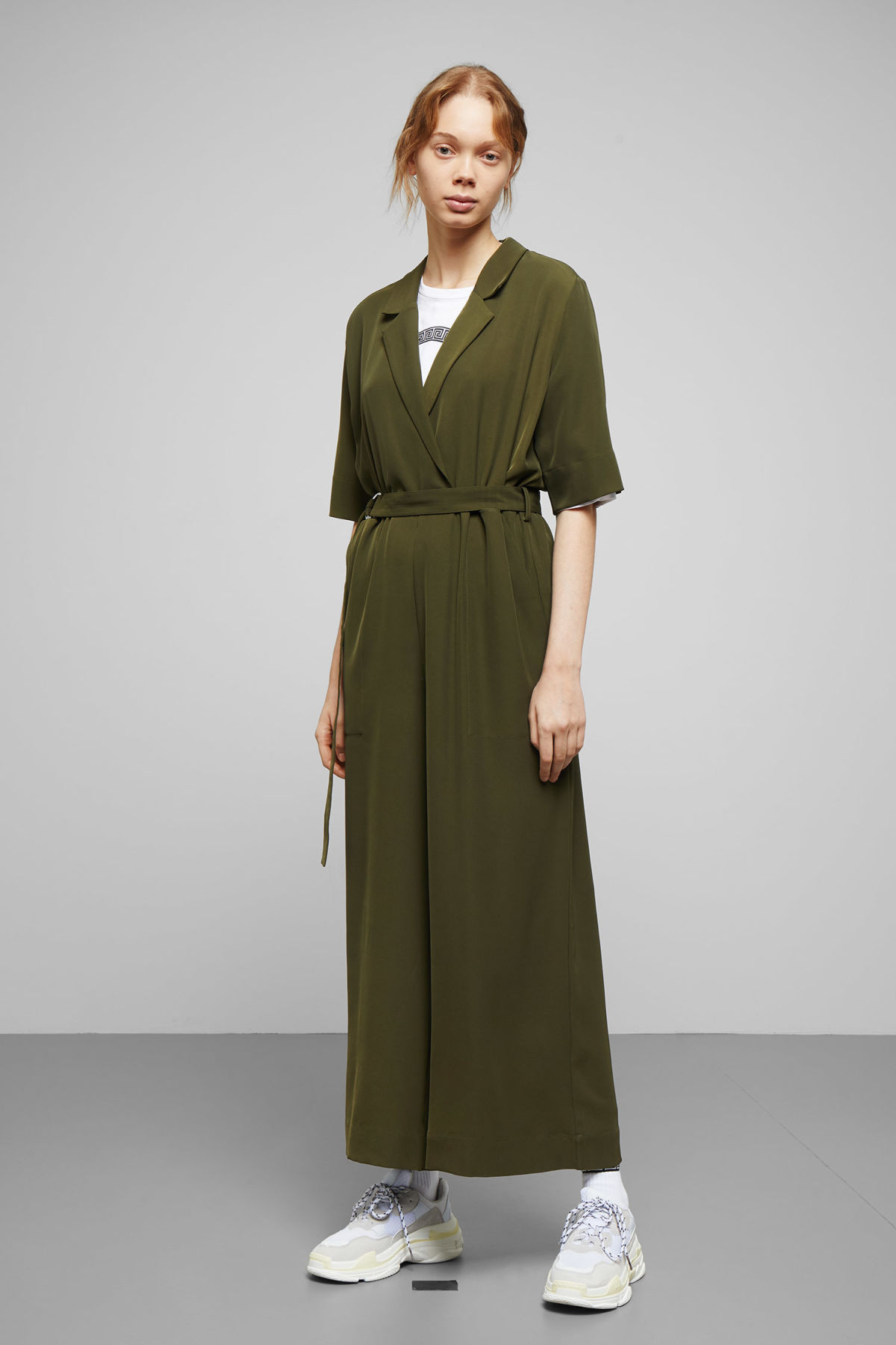 Model front image of Weekday jimi short sleeve jumpsuit in green