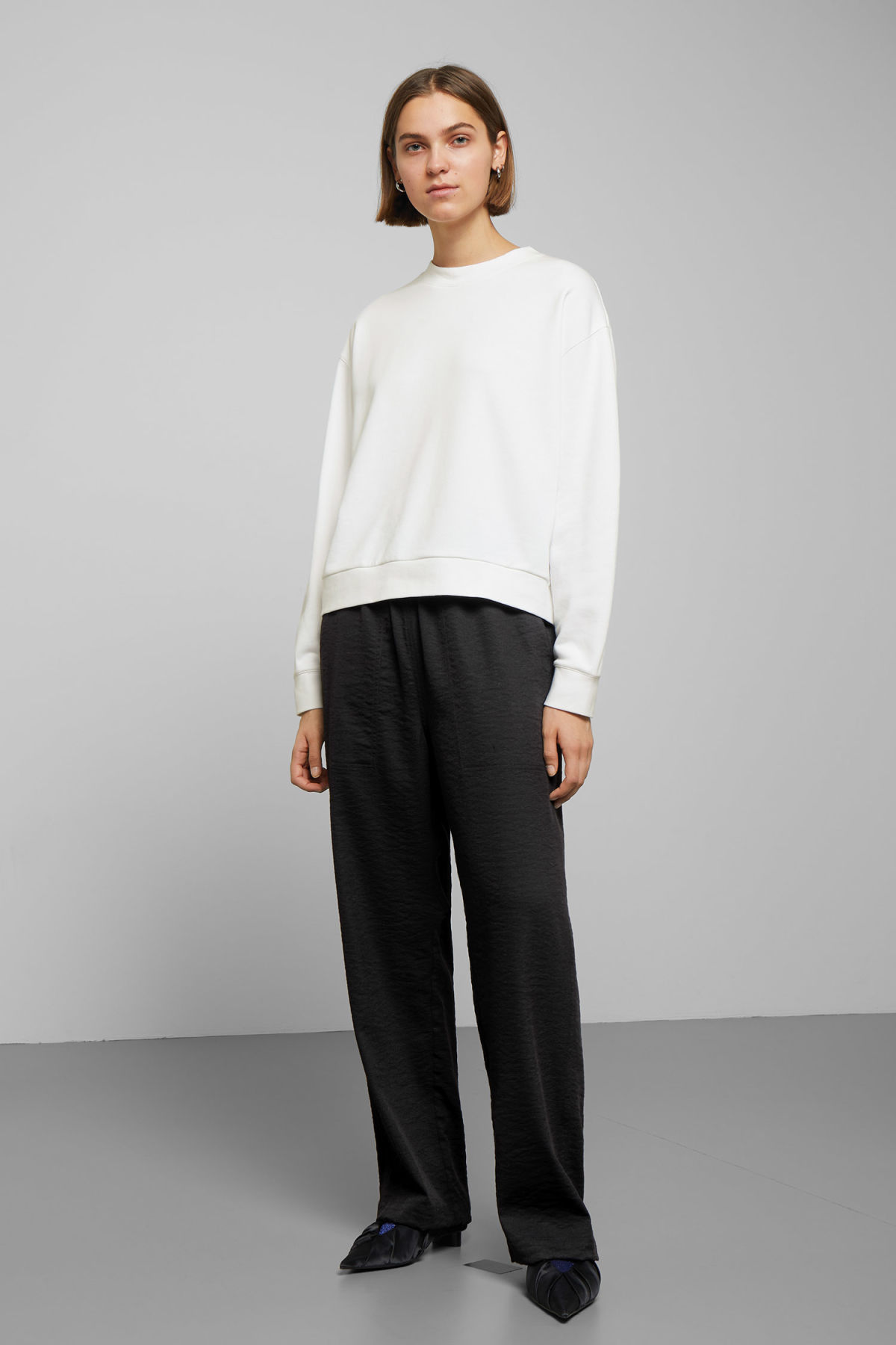 Model side image of Weekday huge cropped sweatshirt  in white