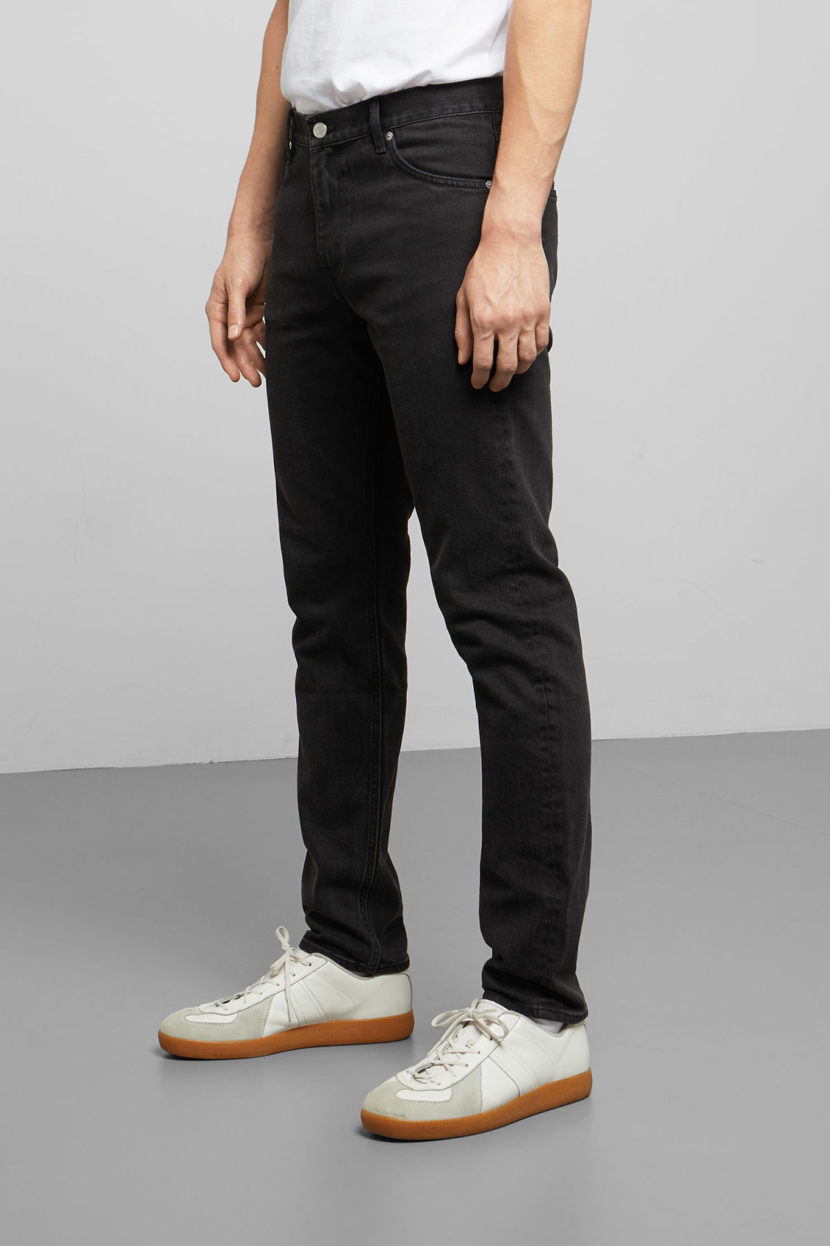 Model side image of Weekday sunday tuned black jeans in black