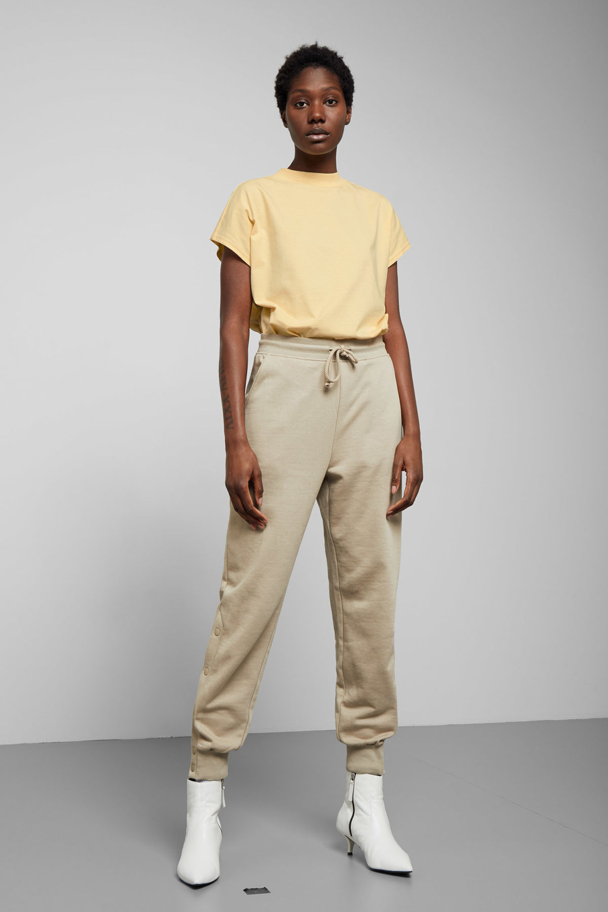 Model side image of Weekday prime t-shirt in yellow