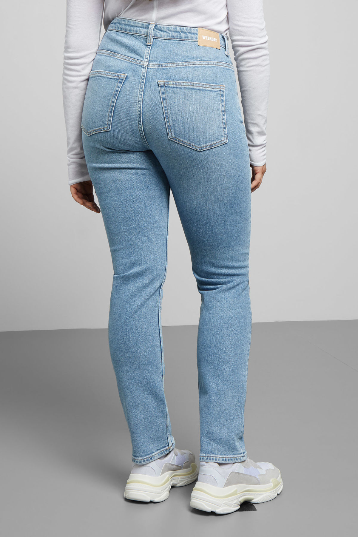 Model side image of Weekday way swish blue jeans in blue