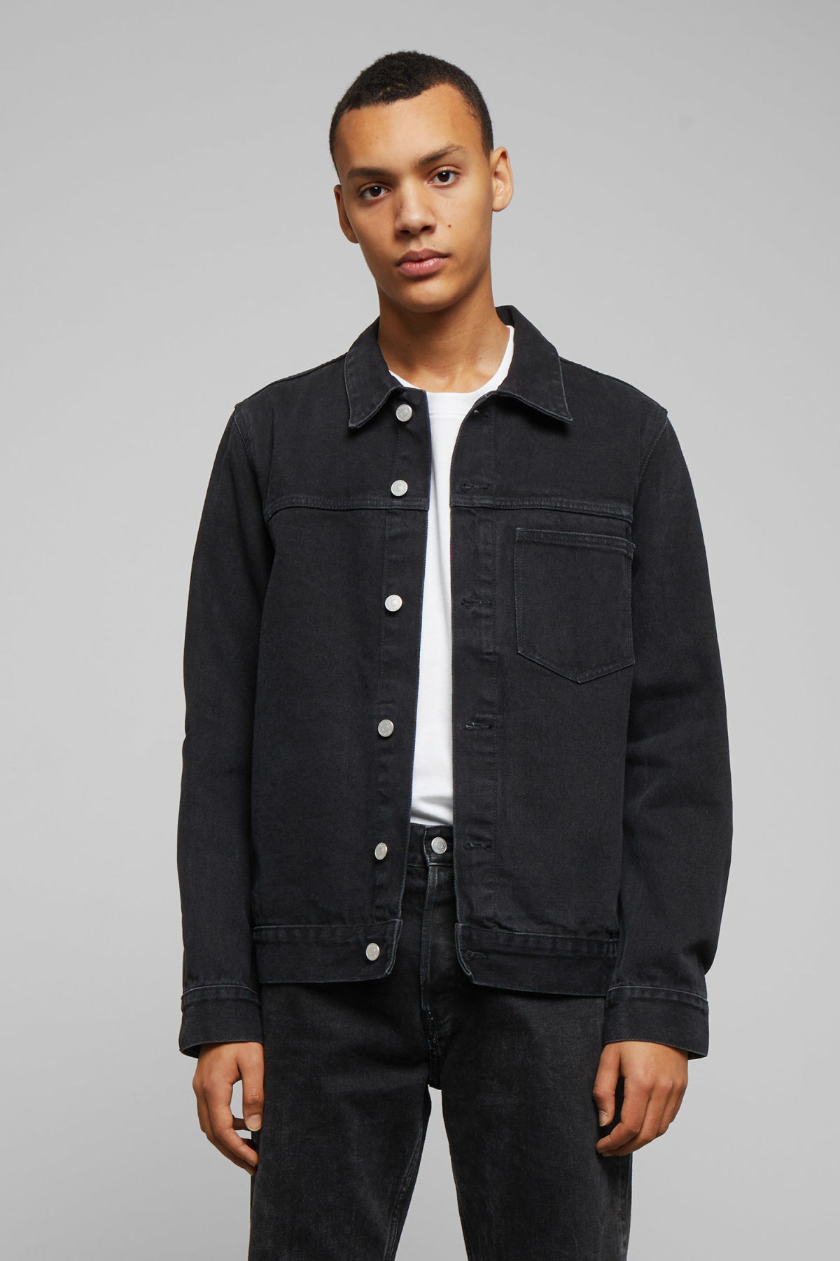 Model side image of Weekday core denim jacket  in black