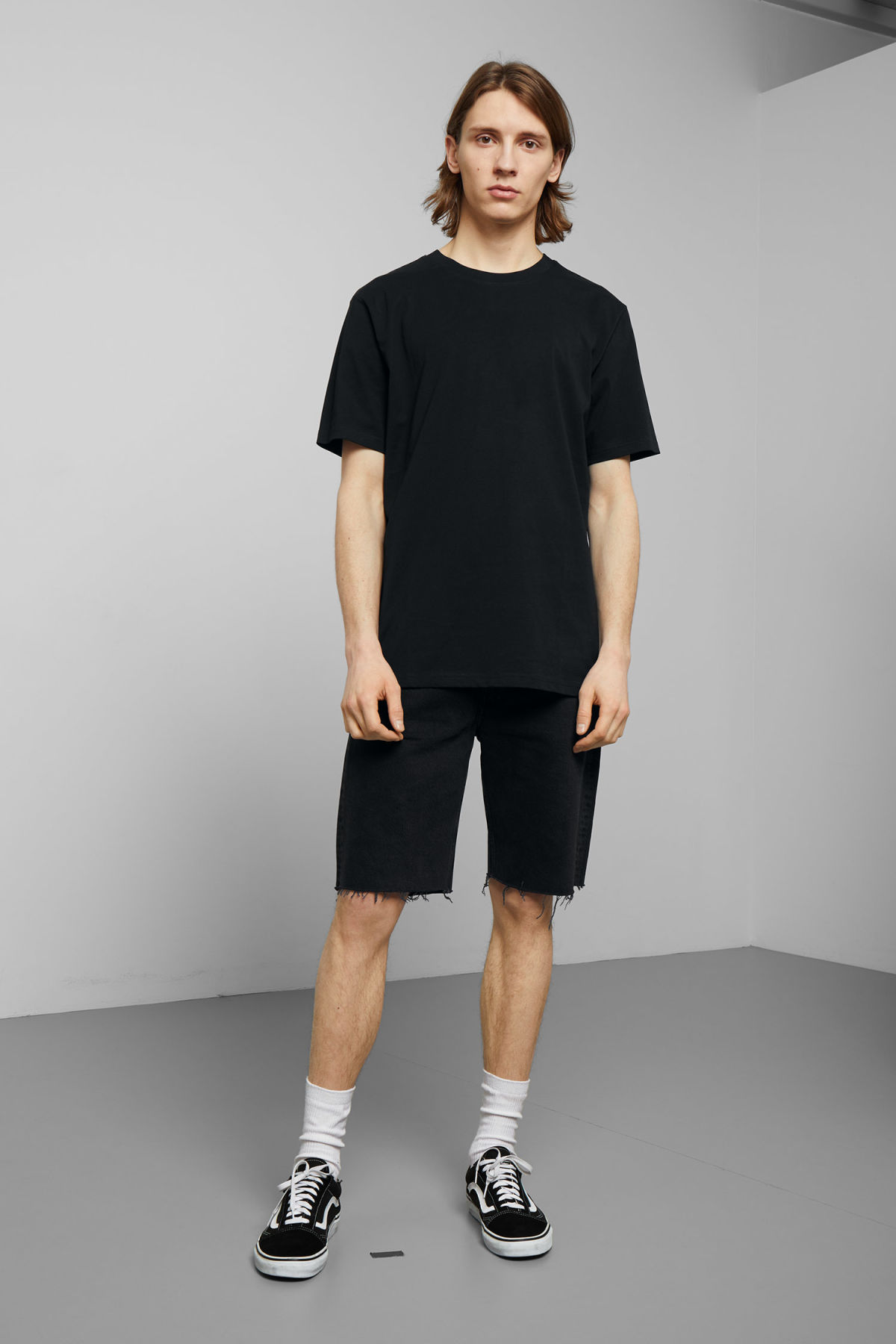 Model side image of Weekday frank t-shirt in black