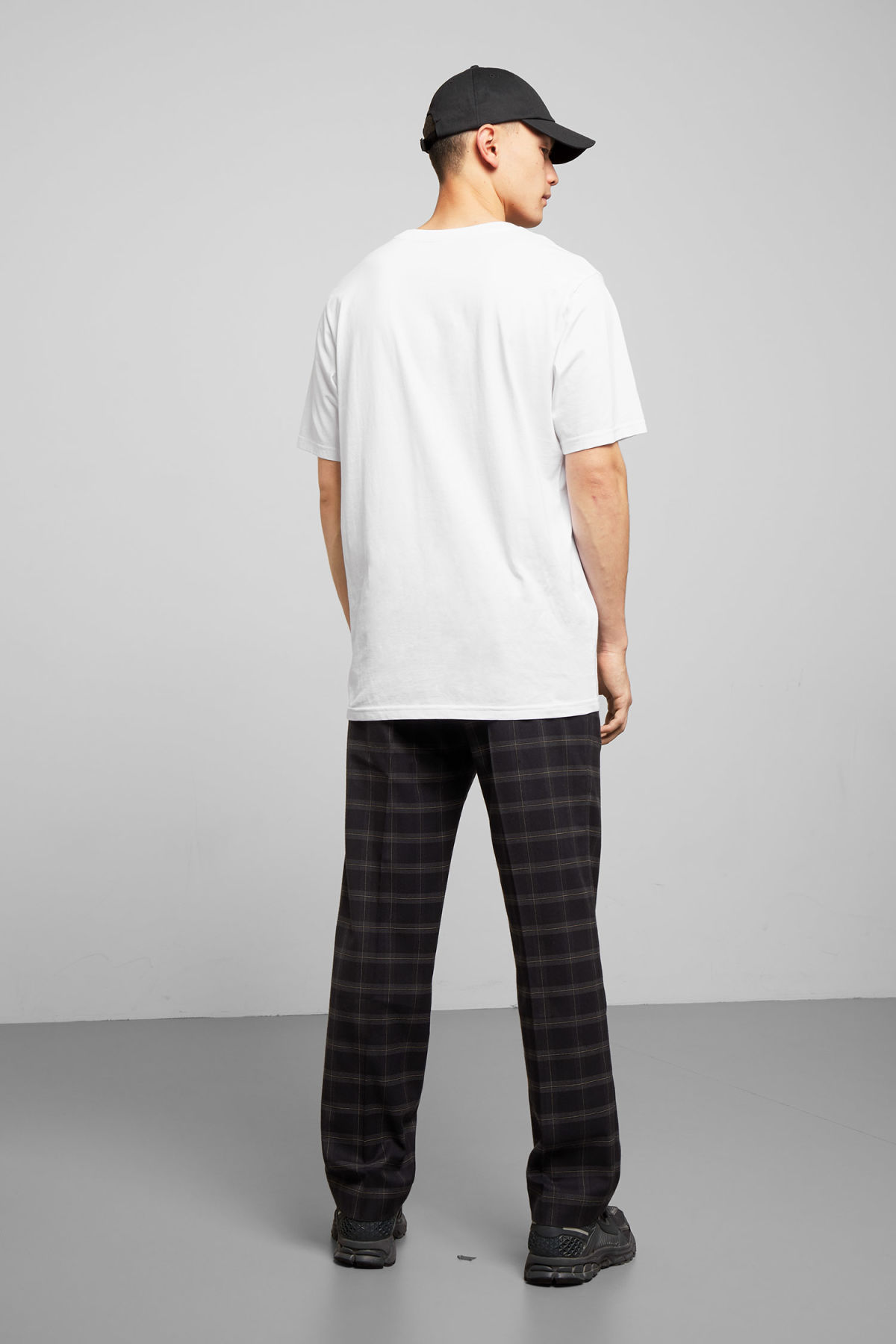 Model side image of Weekday frank t-shirt in white