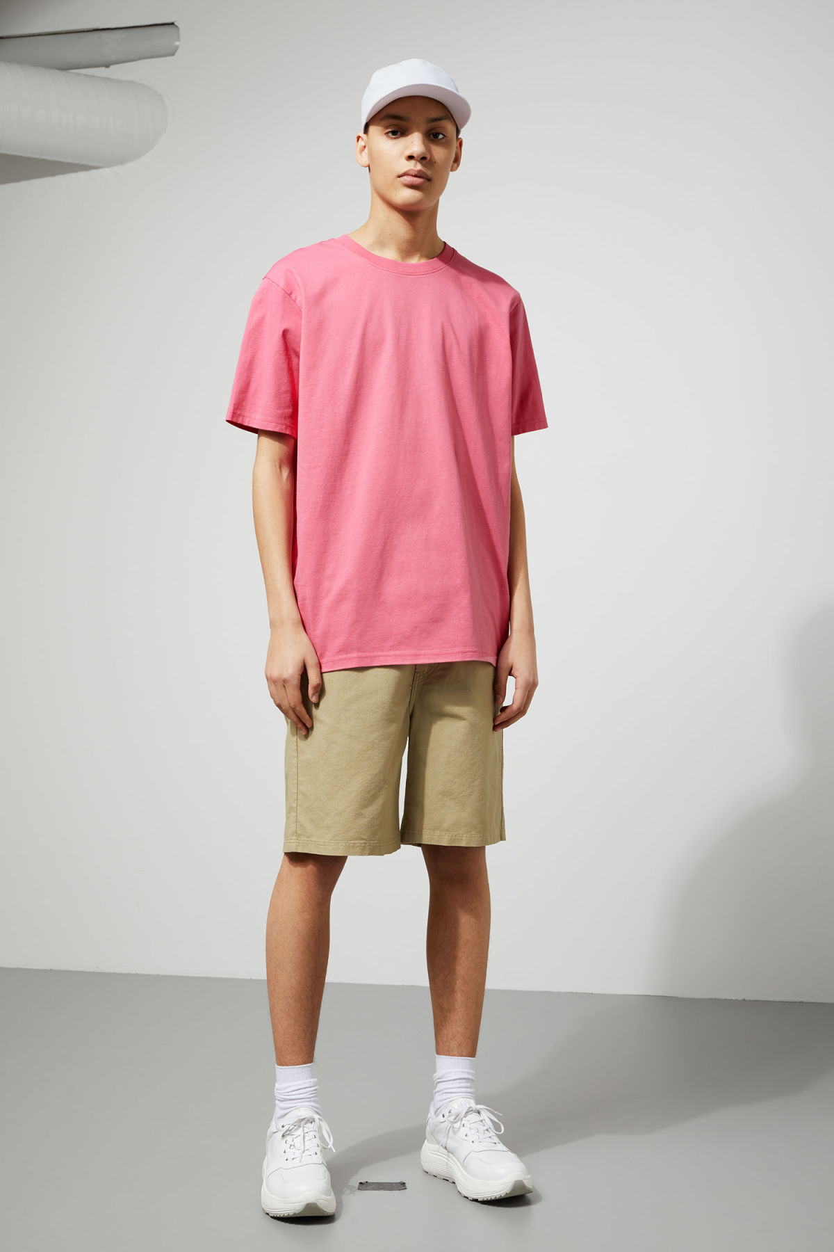 Model side image of Weekday frank t-shirt in pink
