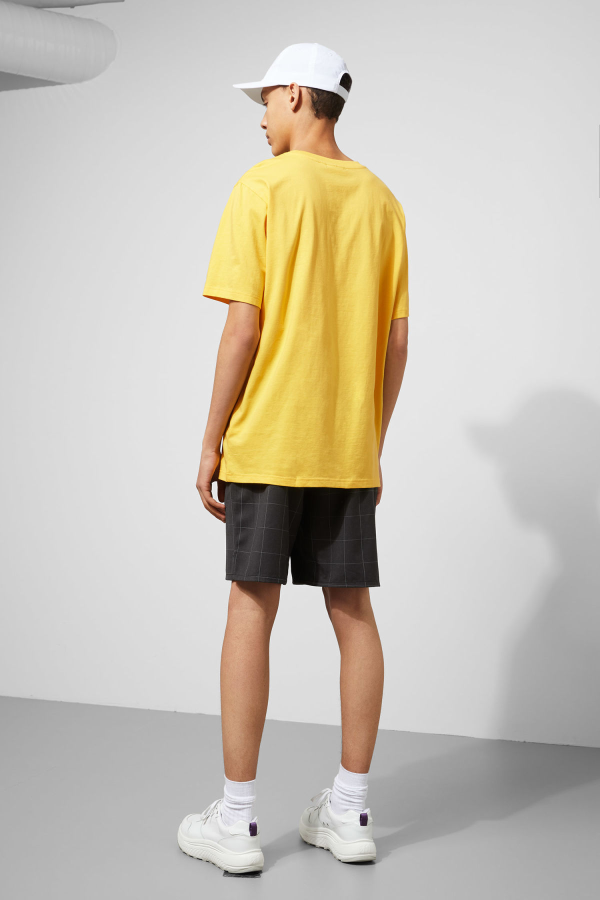 Model side image of Weekday frank t-shirt in yellow