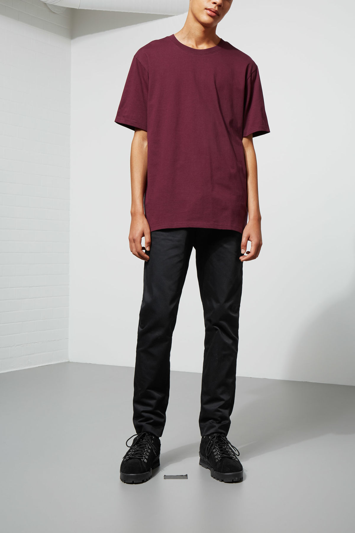 Model side image of Weekday frank t-shirt in red