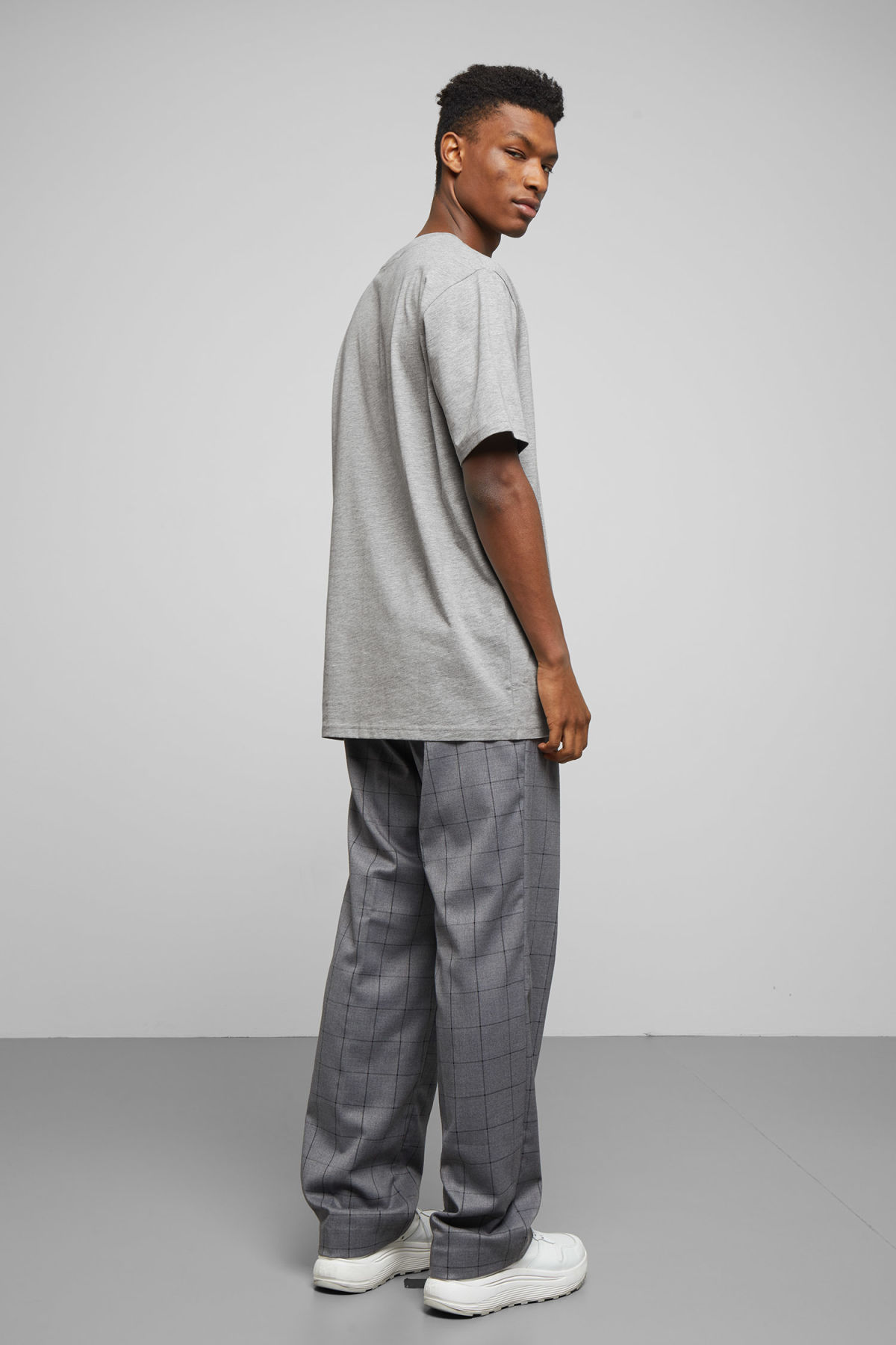 Model side image of Weekday frank t-shirt in grey
