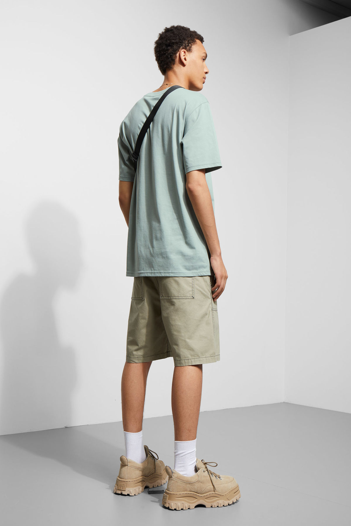 Model back image of Weekday frank t-shirt in turquoise