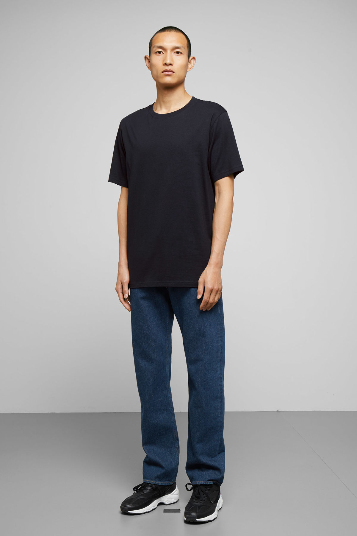 Model side image of Weekday frank t-shirt in blue