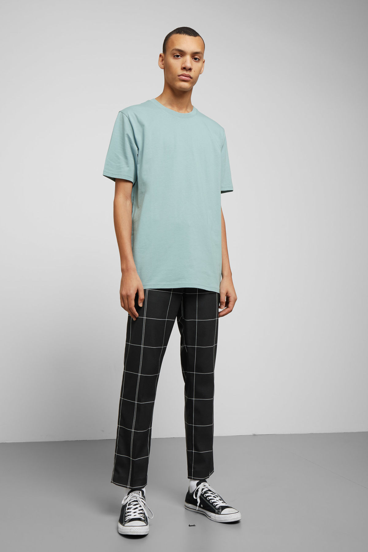 Model side image of Weekday frank t-shirt in turquoise