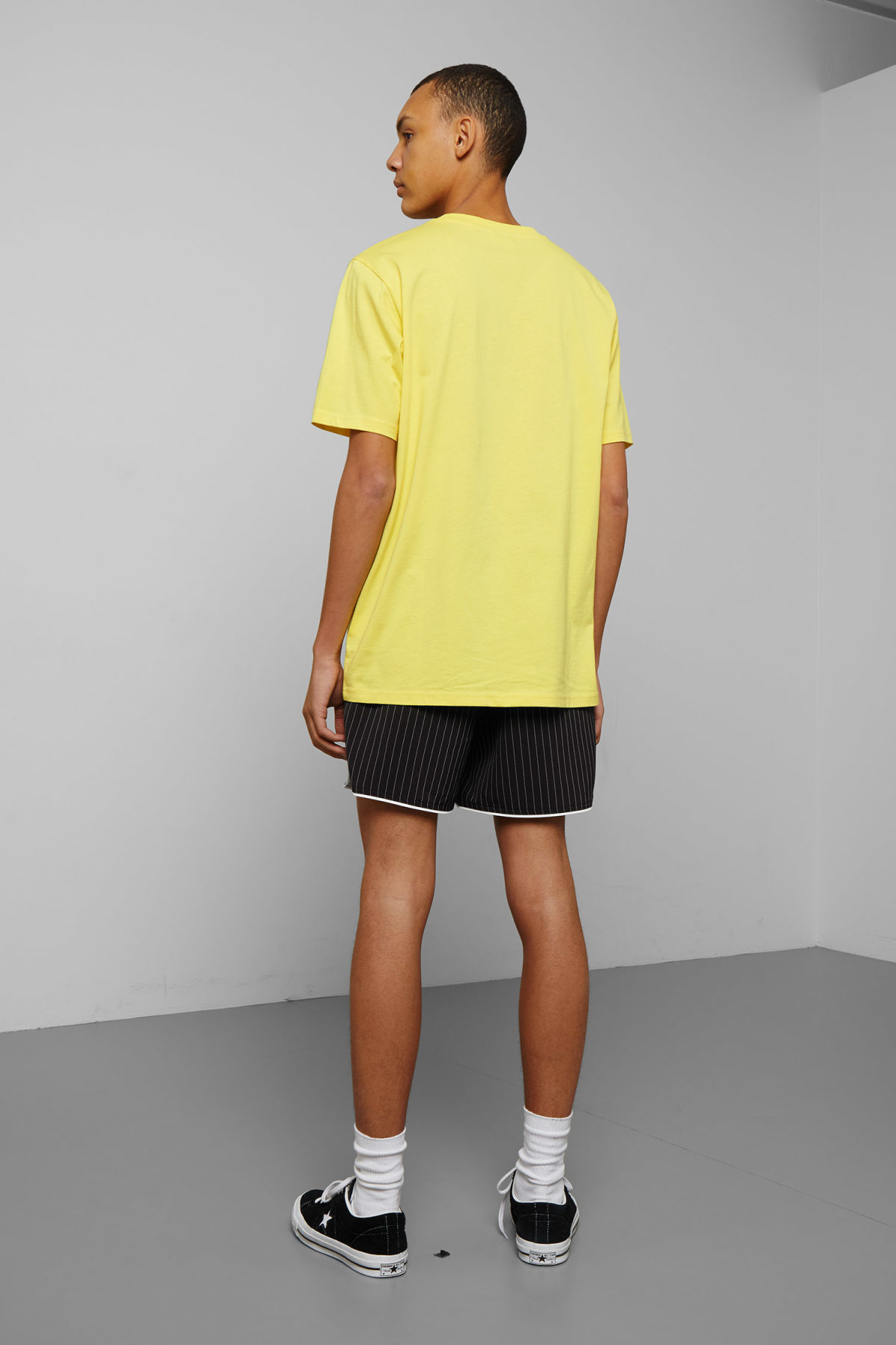Model back image of Weekday frank t-shirt in yellow