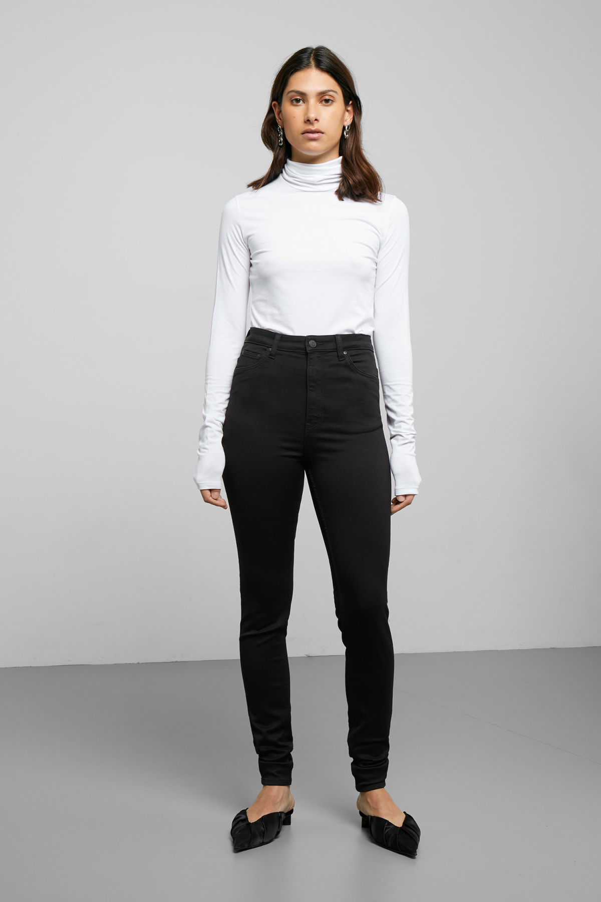 Model front image of Weekday body high satin black jeans in black
