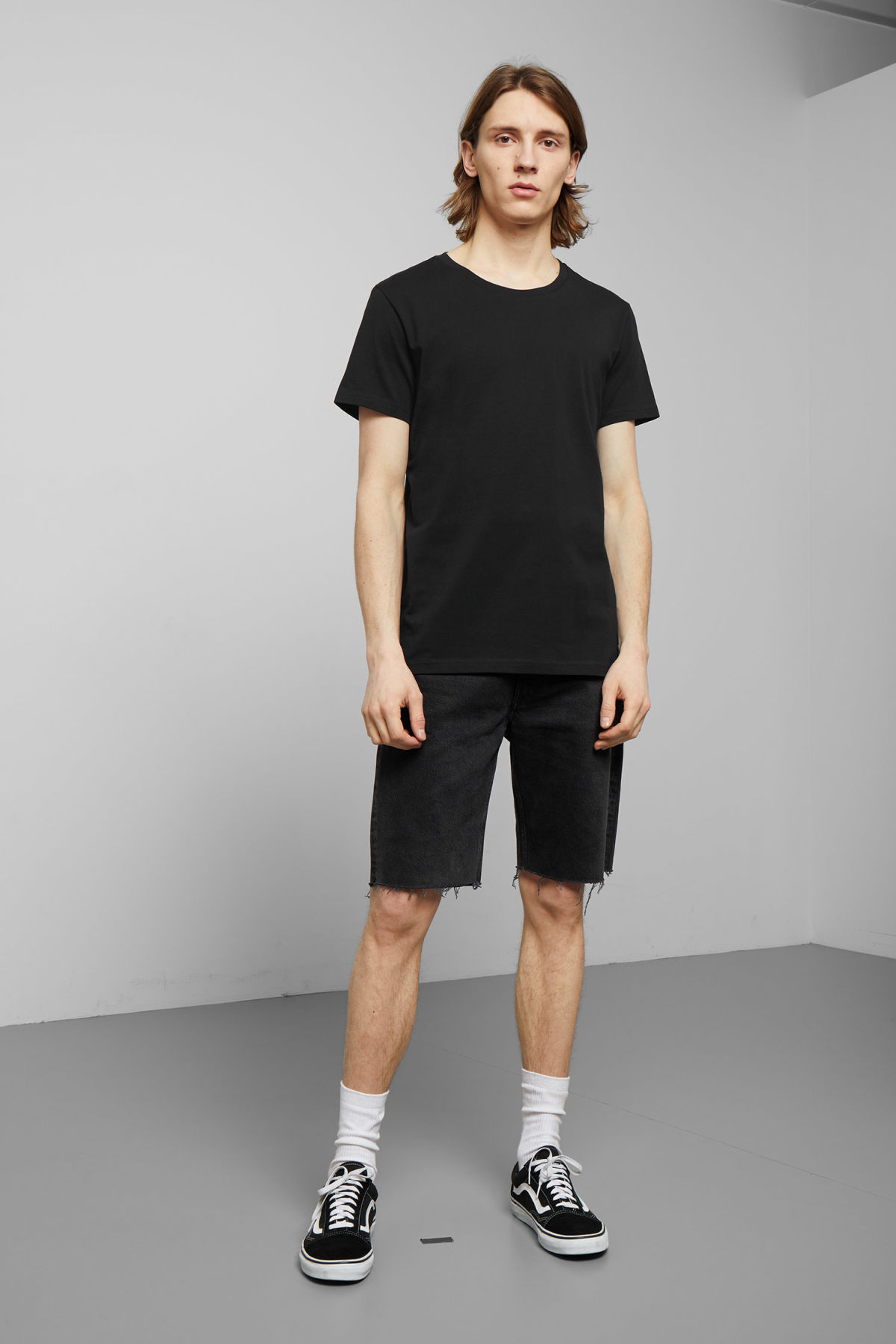 Model side image of Weekday alex t-shirt in black