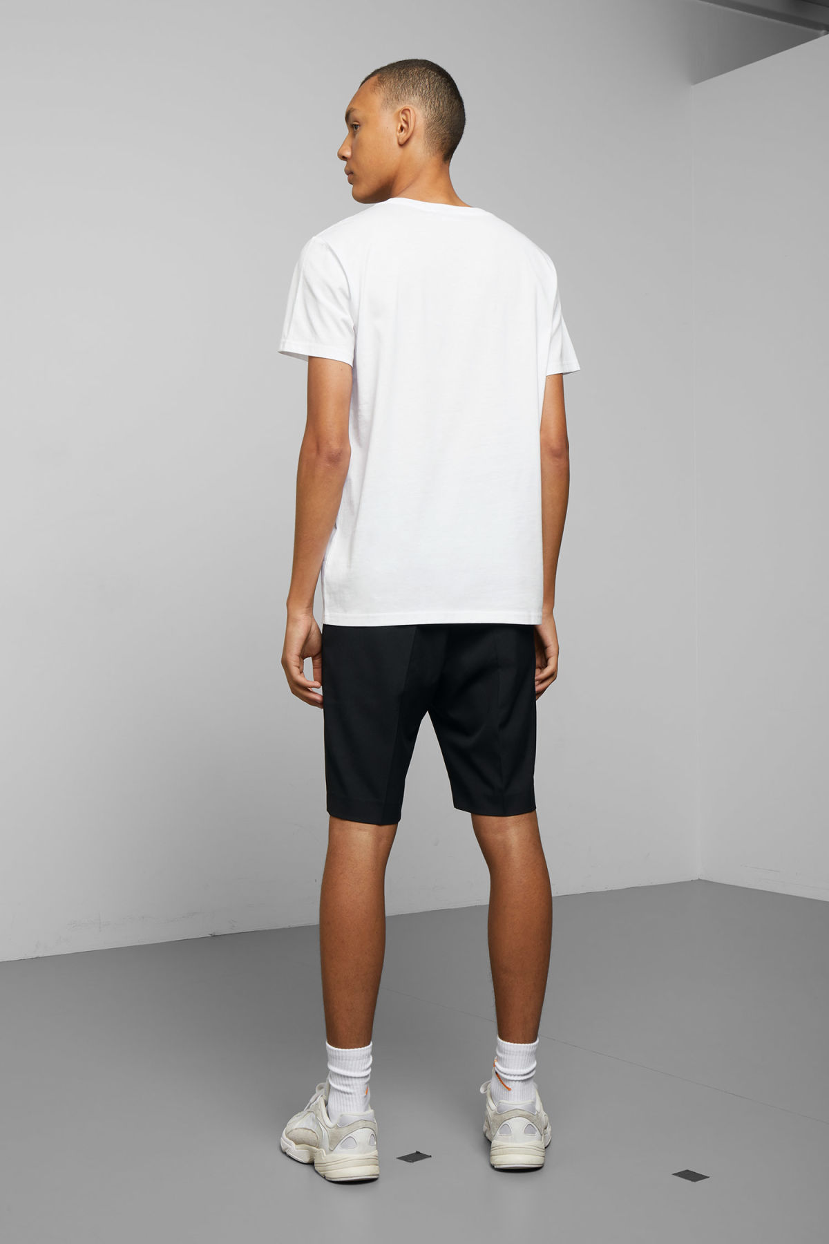 Model back image of Weekday alex t-shirt in white