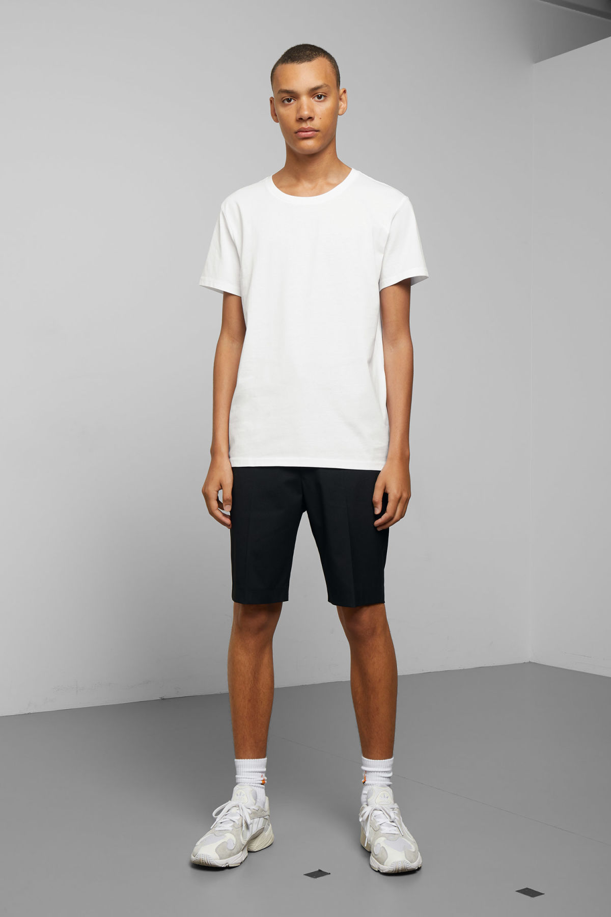 Model side image of Weekday alex t-shirt in white
