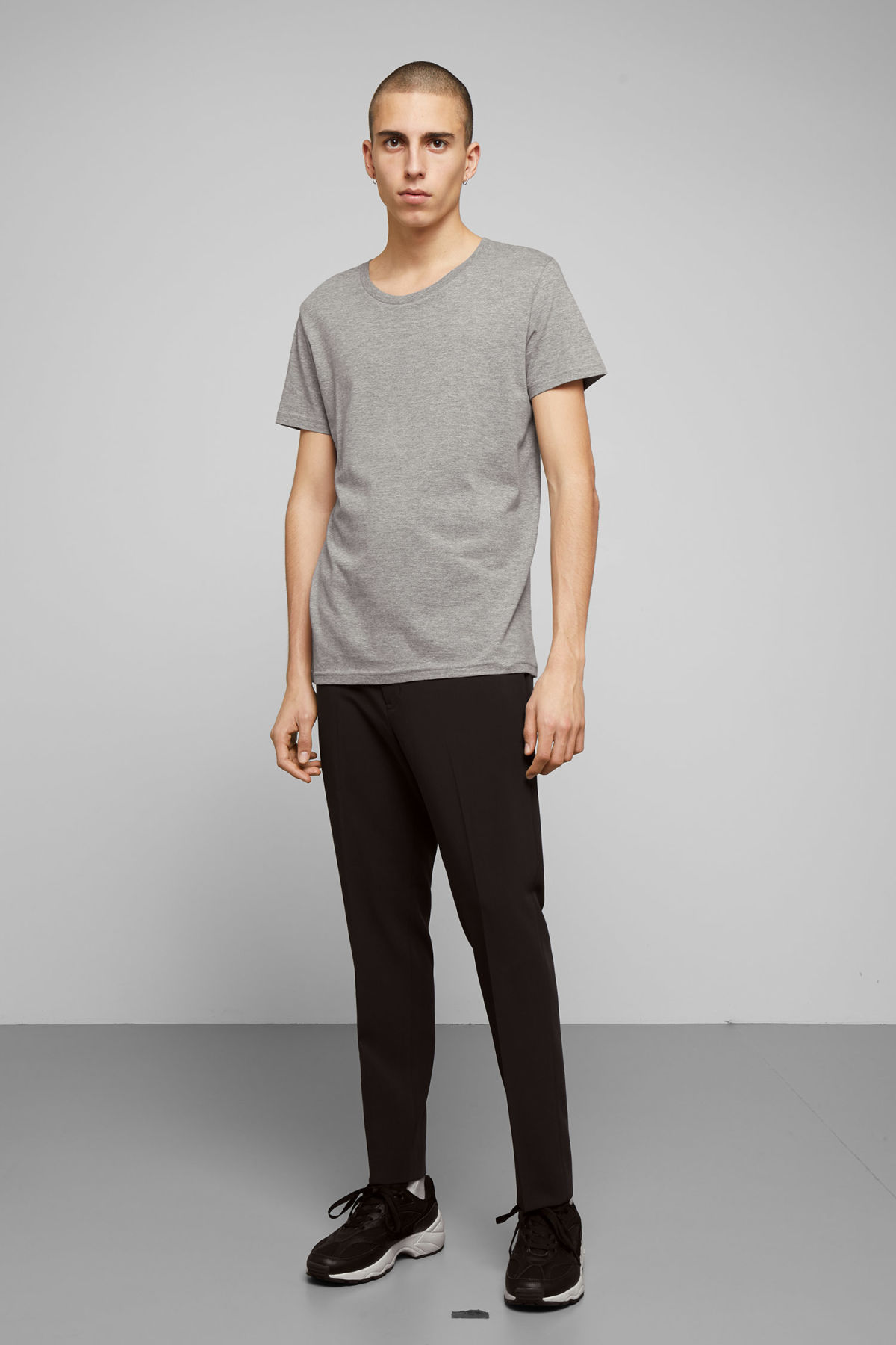 Model side image of Weekday alex t-shirt in grey