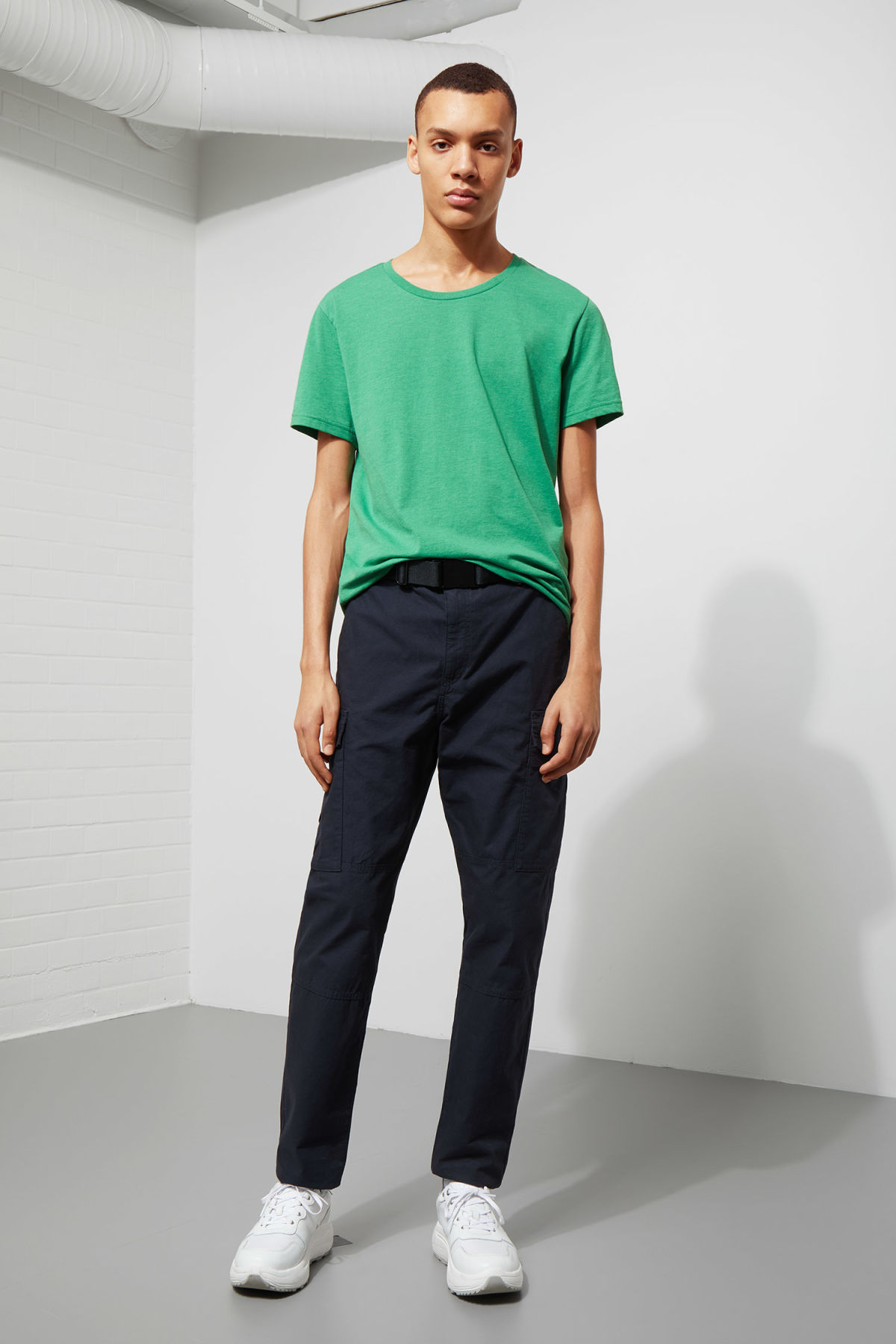 Model side image of Weekday alex t-shirt in green