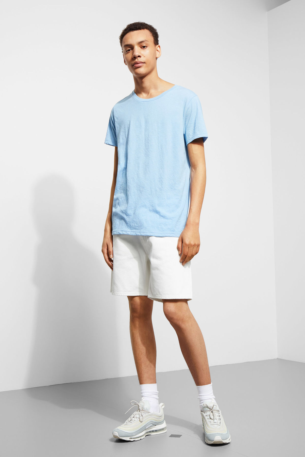 Model side image of Weekday alex t-shirt in blue