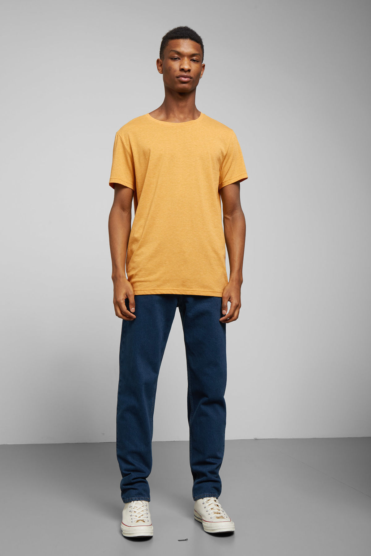 Model side image of Weekday alex t-shirt in yellow