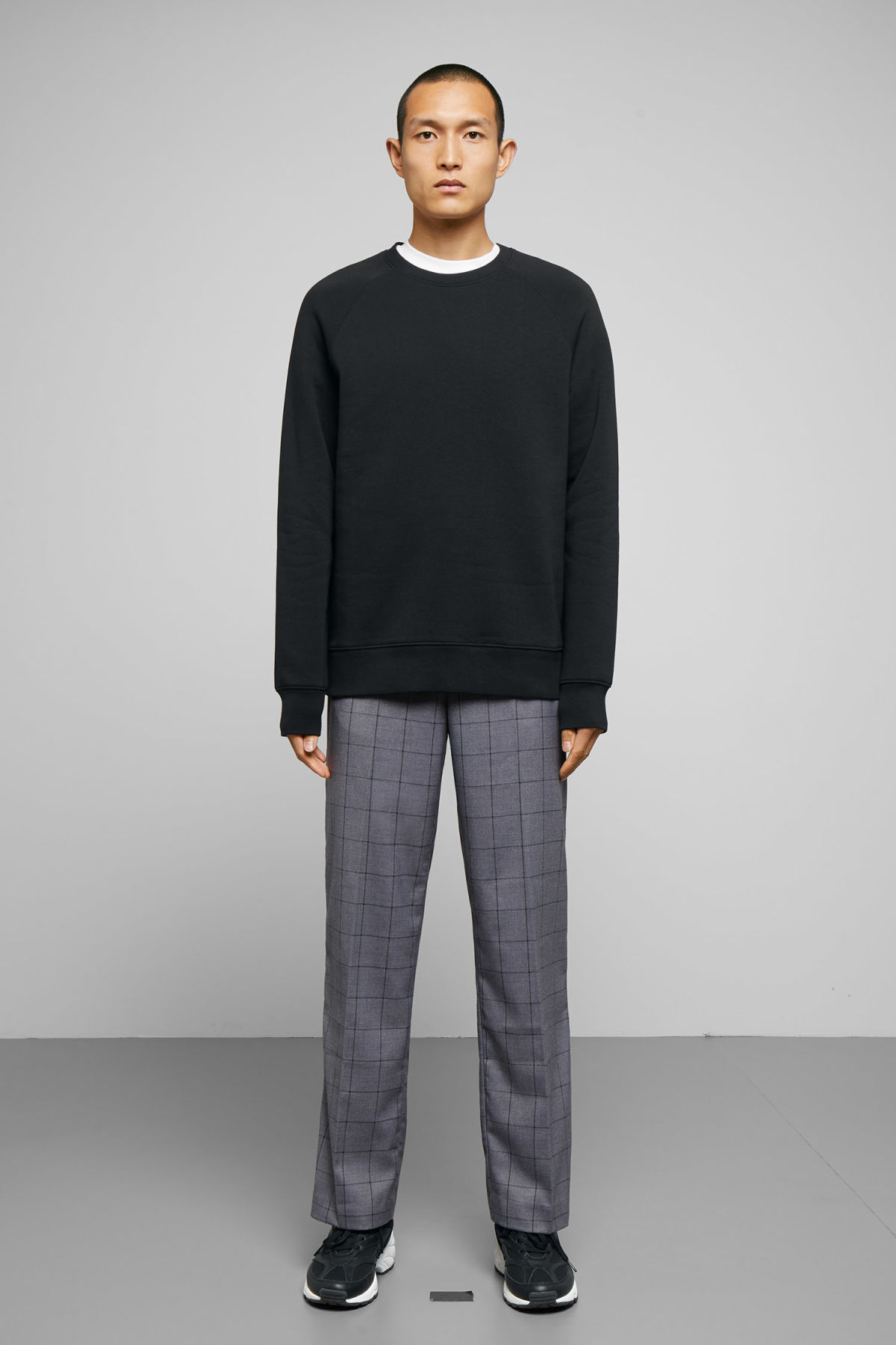 Model side image of Weekday paris sweatshirt in black