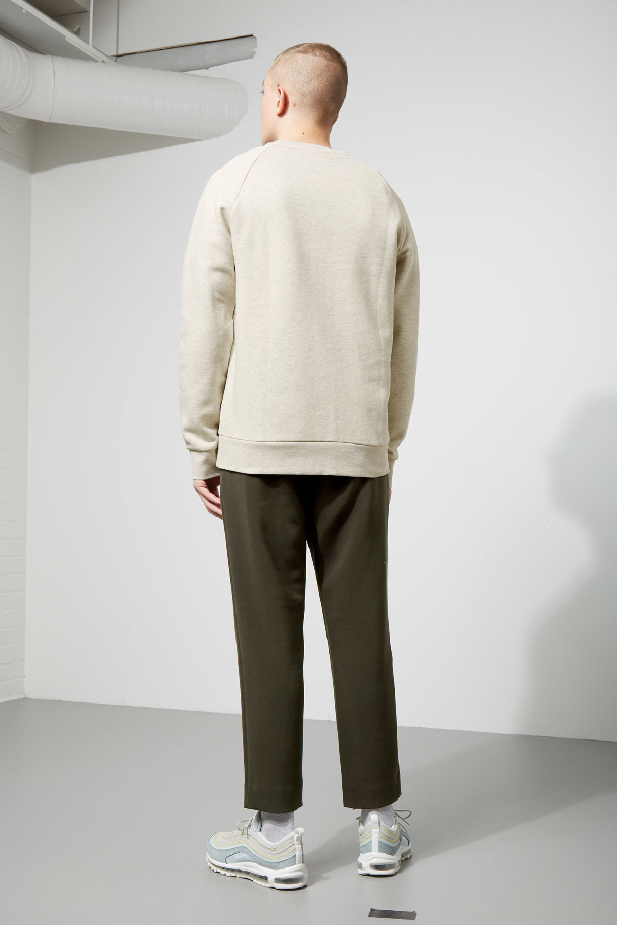 Model side image of Weekday paris sweatshirt in brown