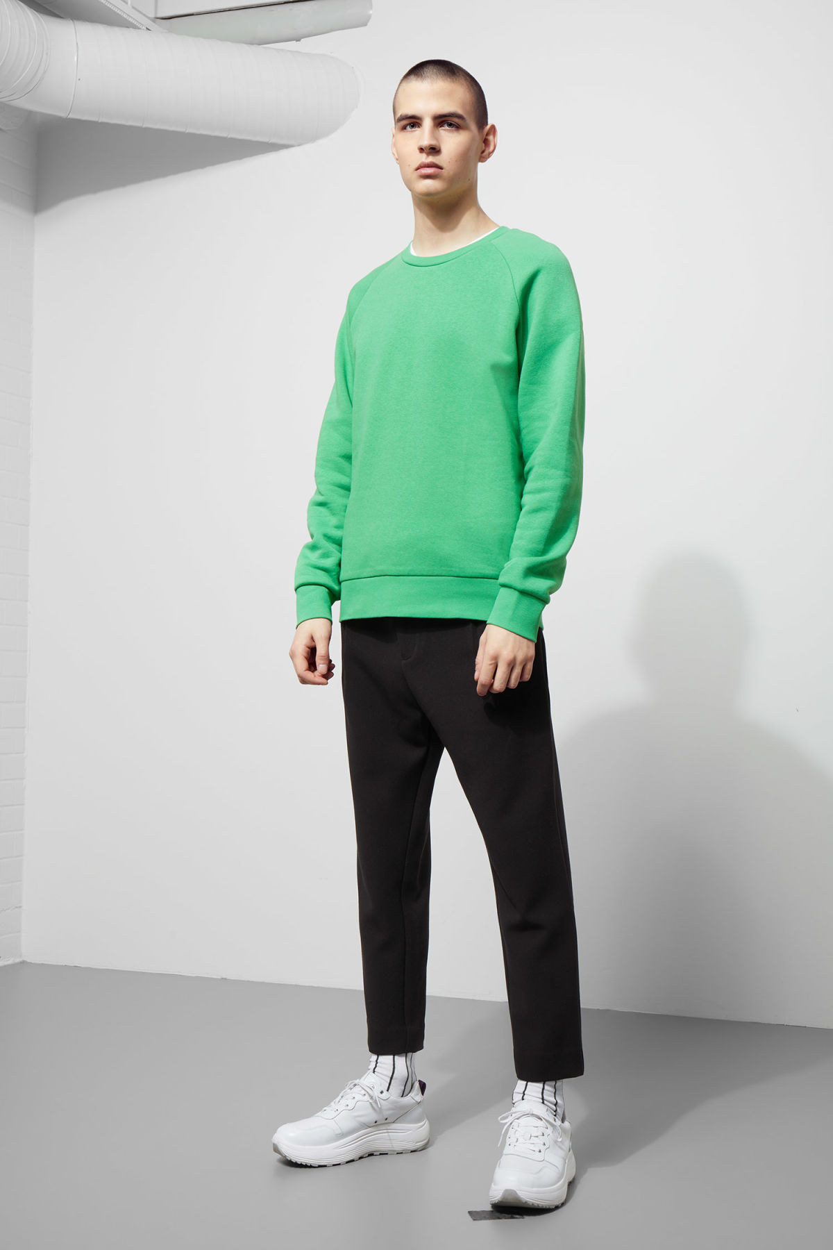 Model side image of Weekday paris sweatshirt in green