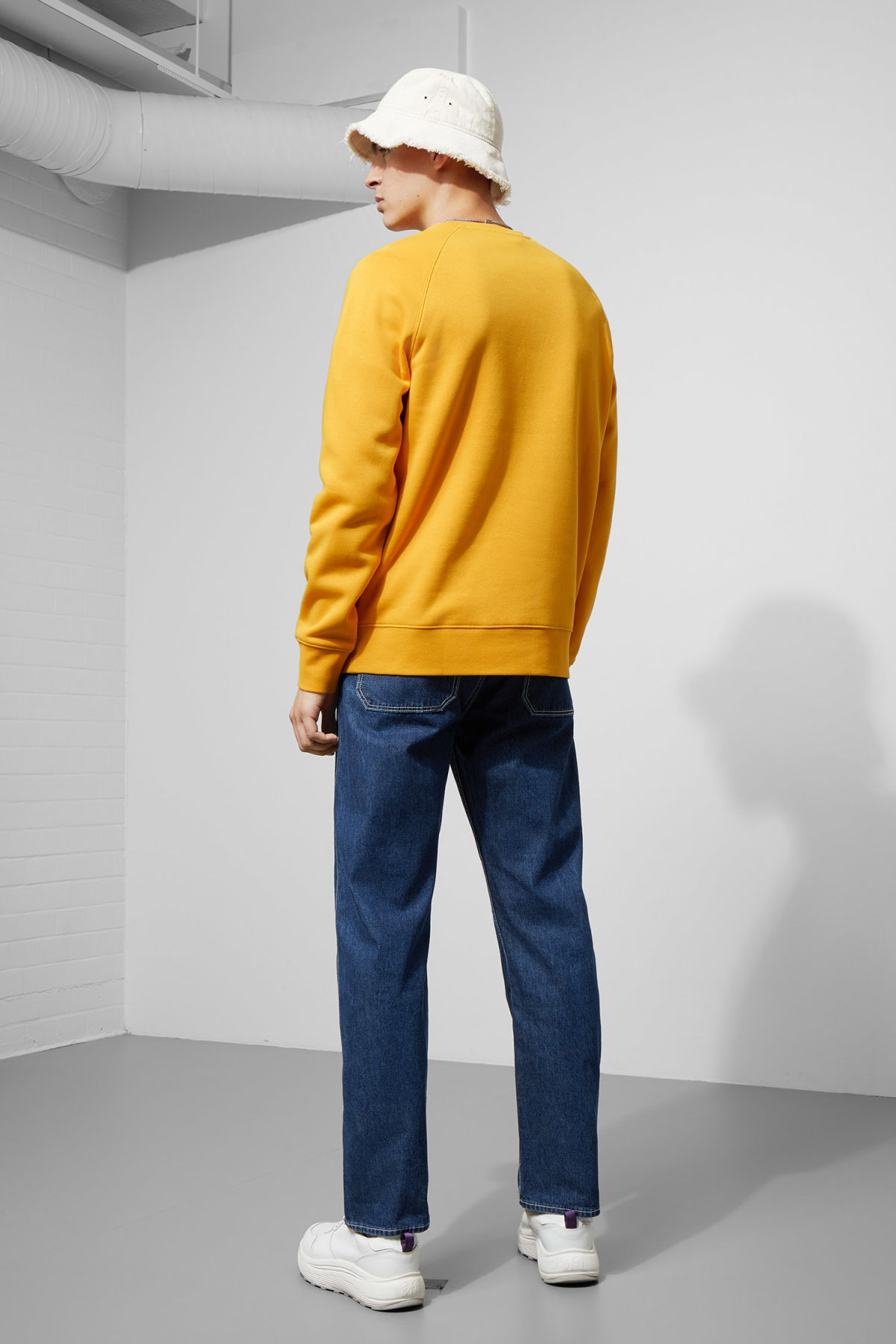 Model back image of Weekday paris sweatshirt in yellow