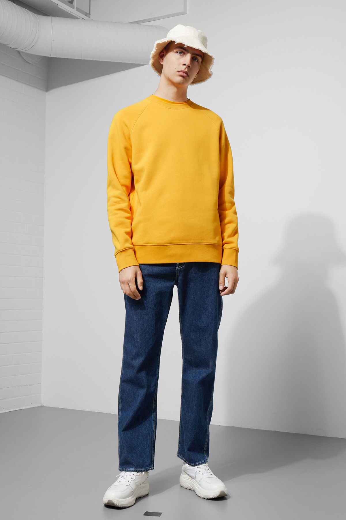 Model side image of Weekday paris sweatshirt in yellow