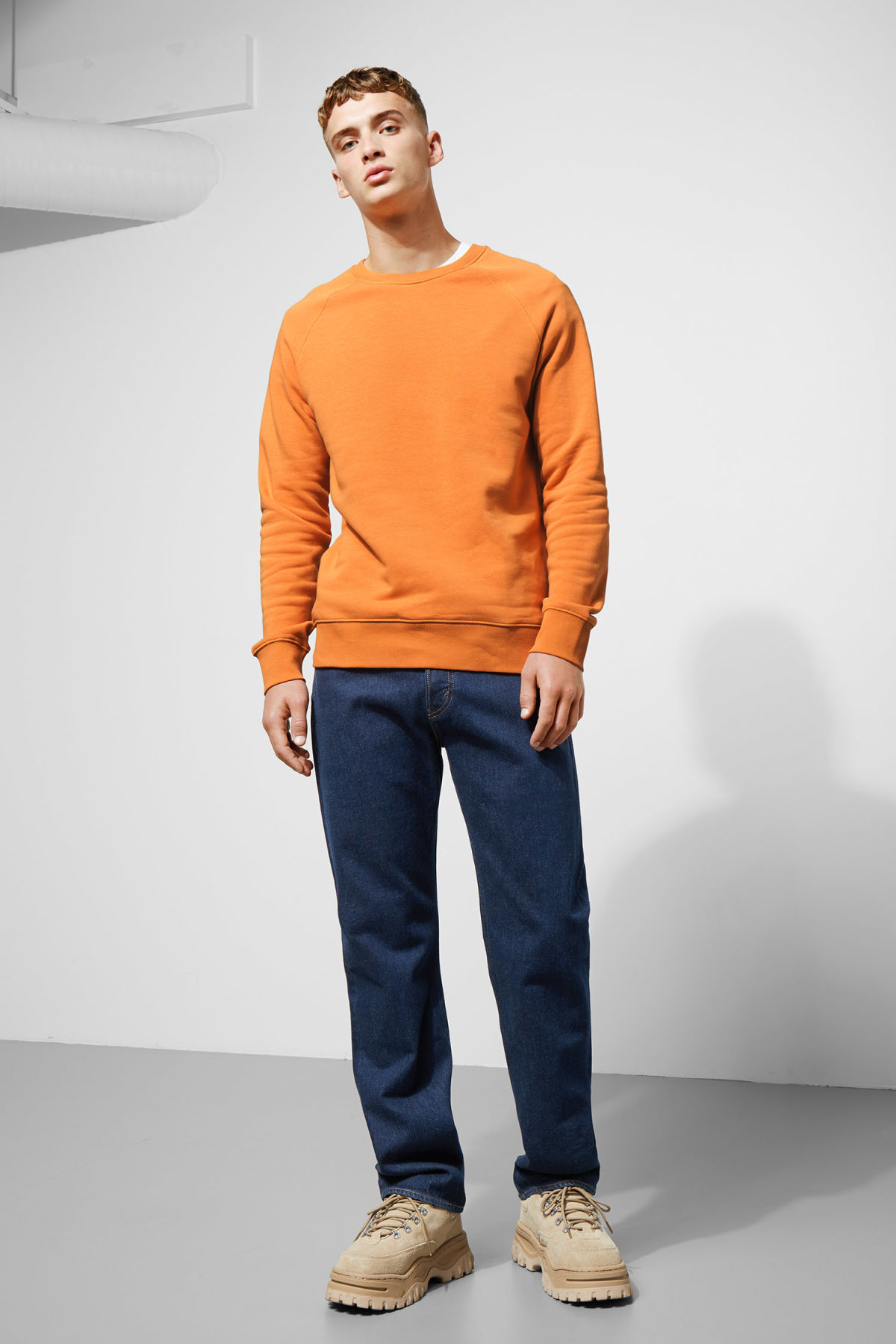 Model side image of Weekday paris sweatshirt in orange