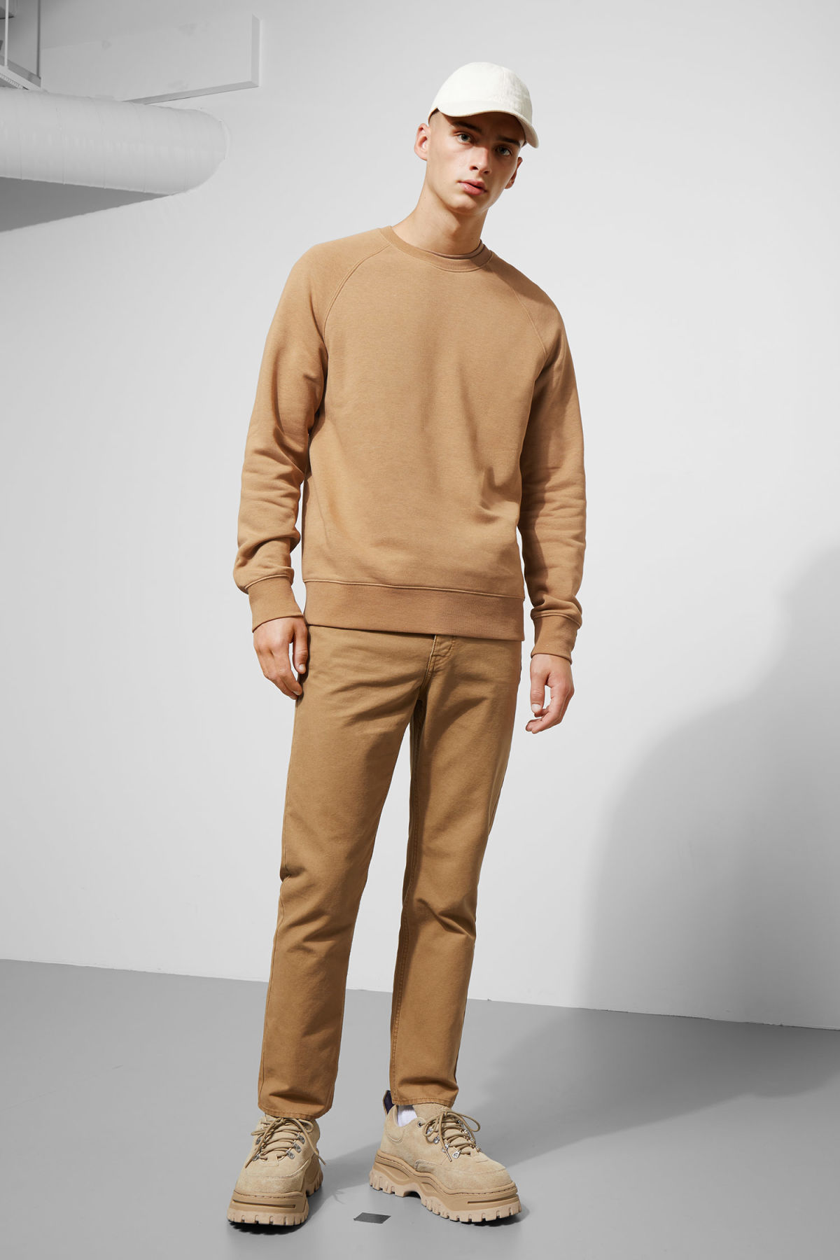 Model side image of Weekday paris sweatshirt in beige