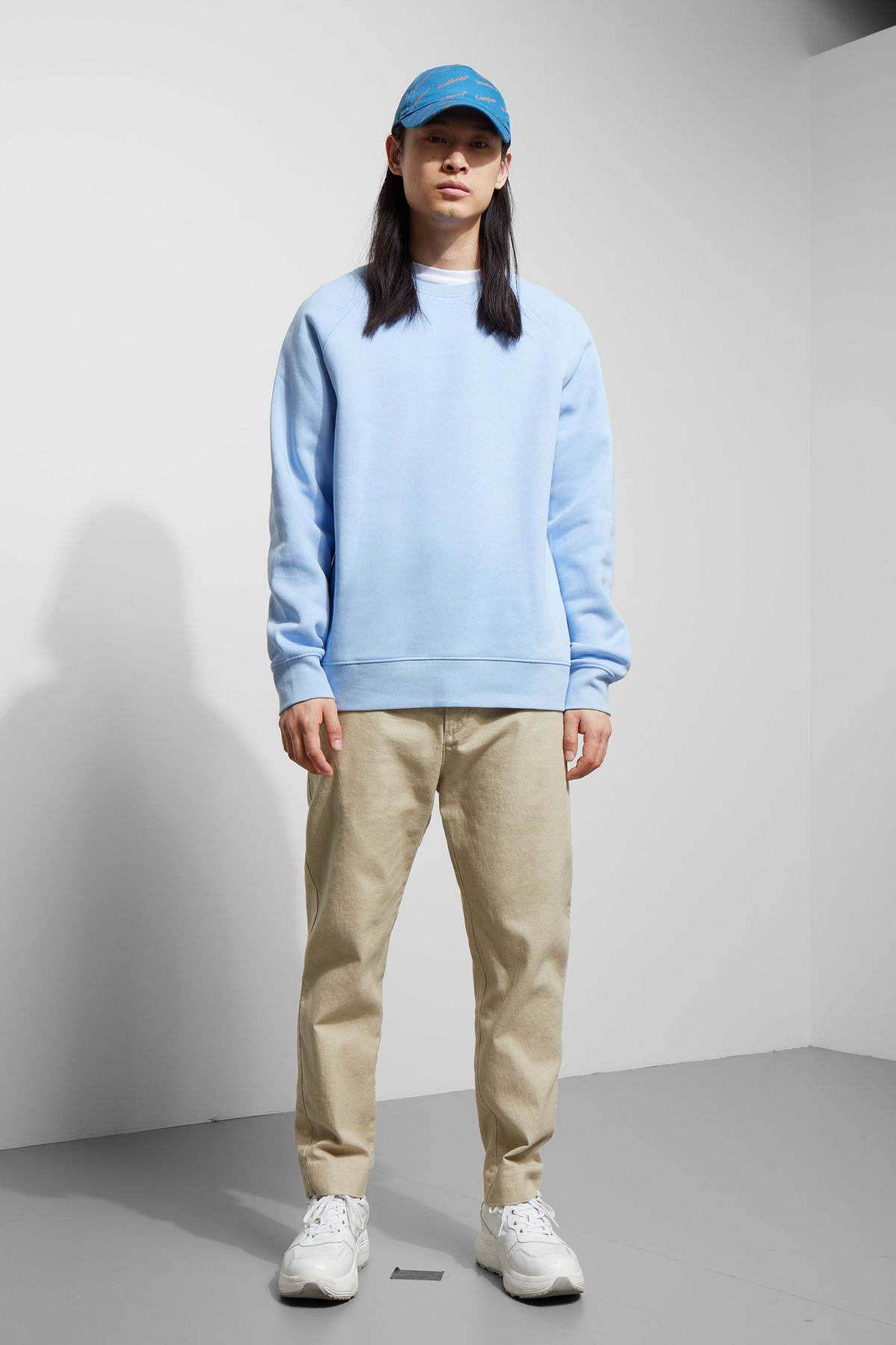 Model side image of Weekday paris sweatshirt in blue