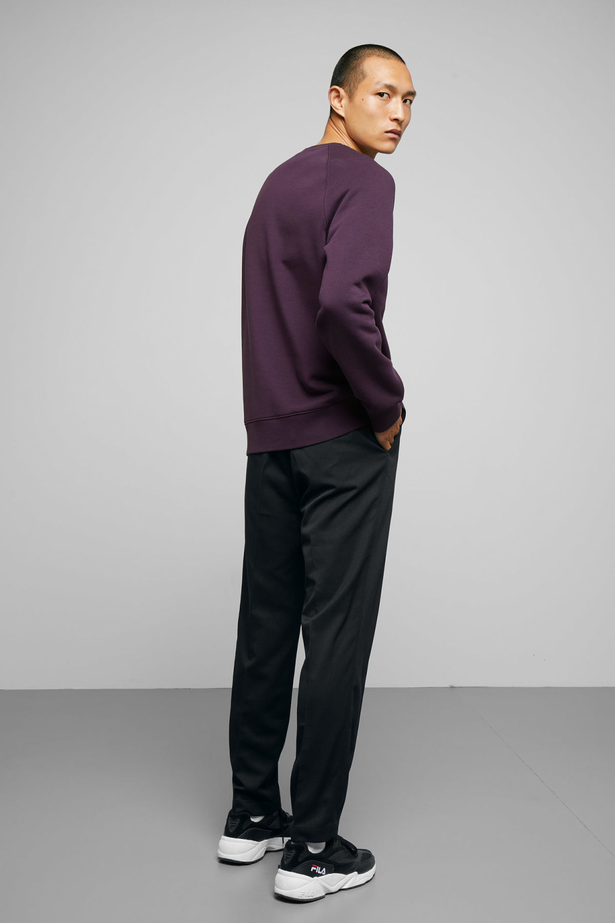 Model side image of Weekday paris sweatshirt in purple