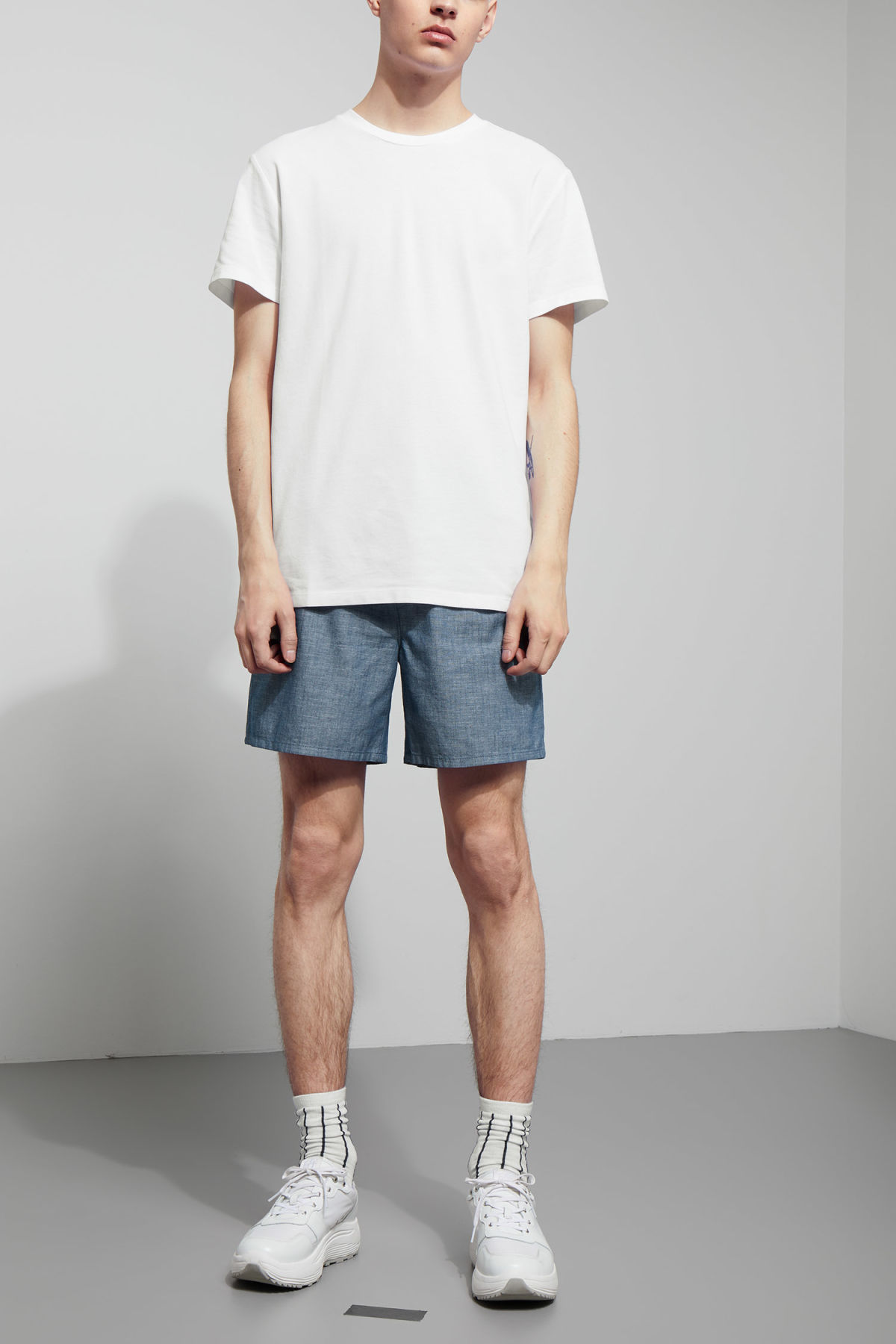 Model side image of Weekday tennis t-shirt in white