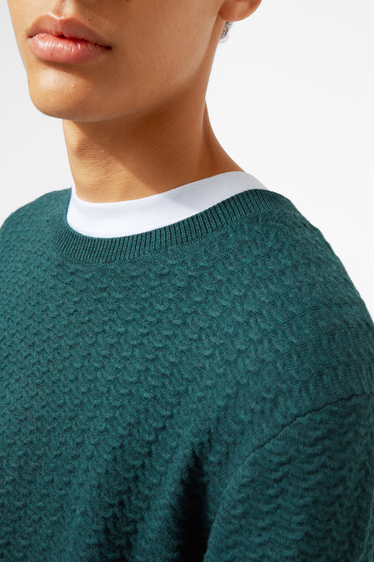Model front image of Weekday john knit sweater in turquoise