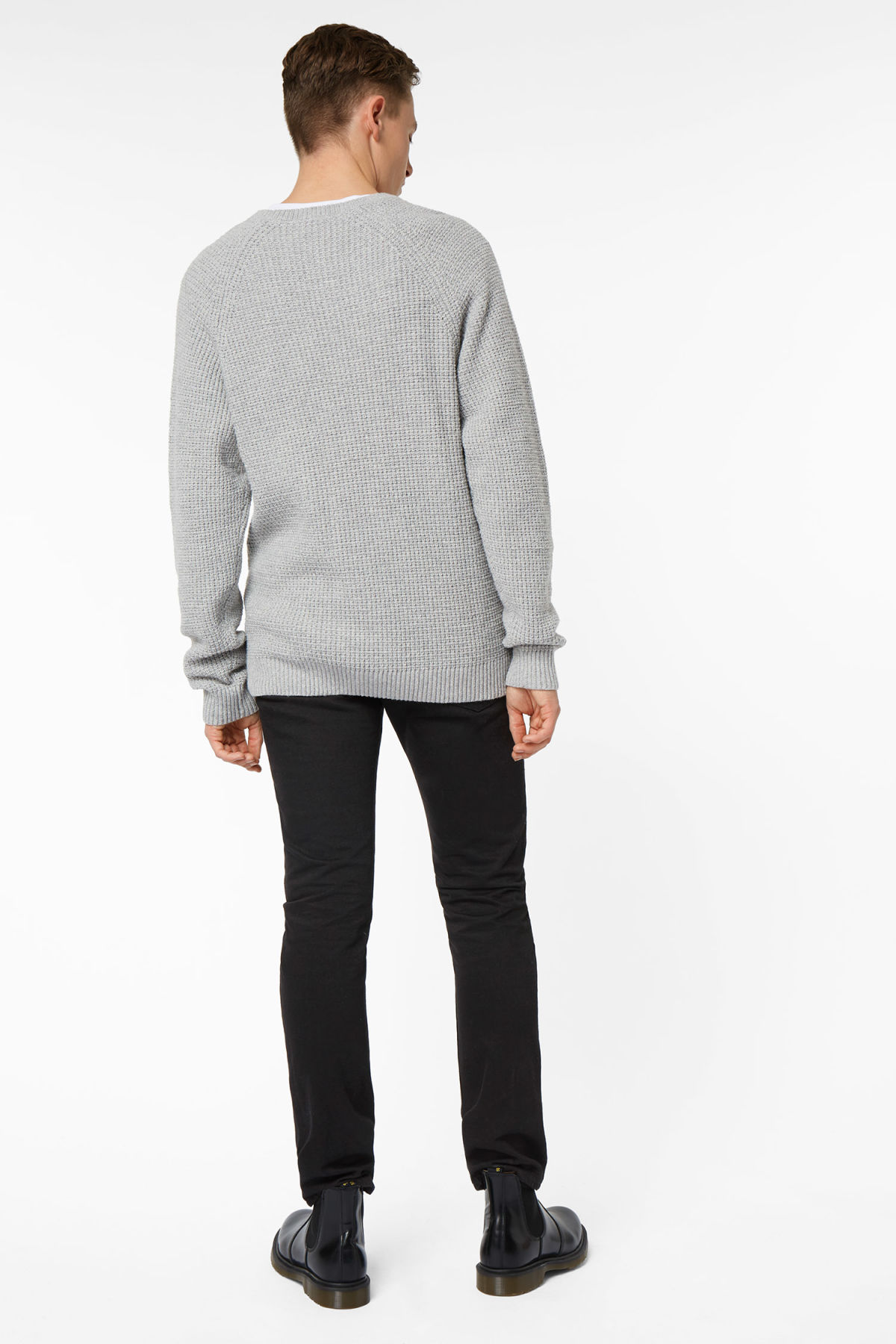 Model side image of Weekday parker waffle sweater in grey