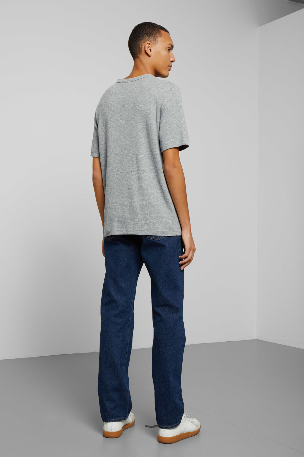 Model side image of Weekday grinko t-shirt in grey