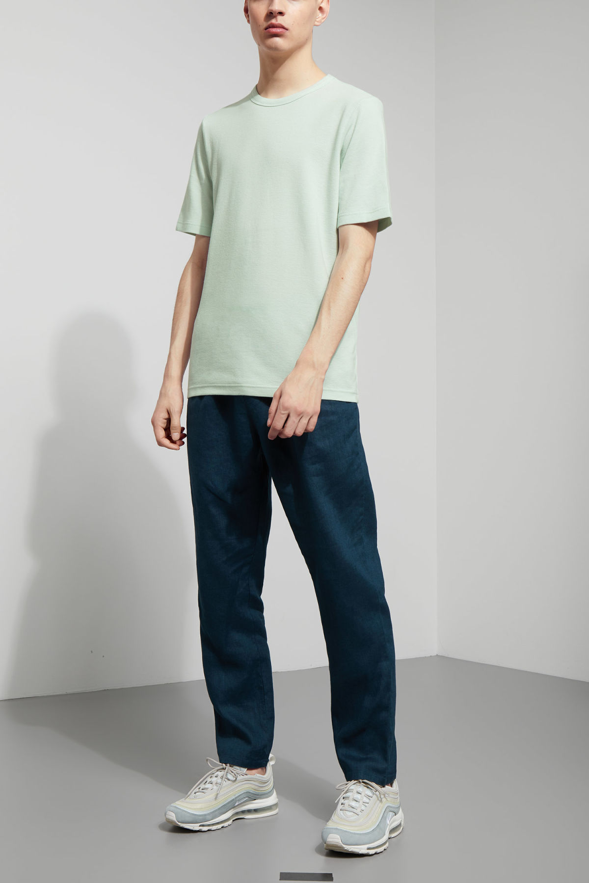 Model side image of Weekday grinko t-shirt in turquoise