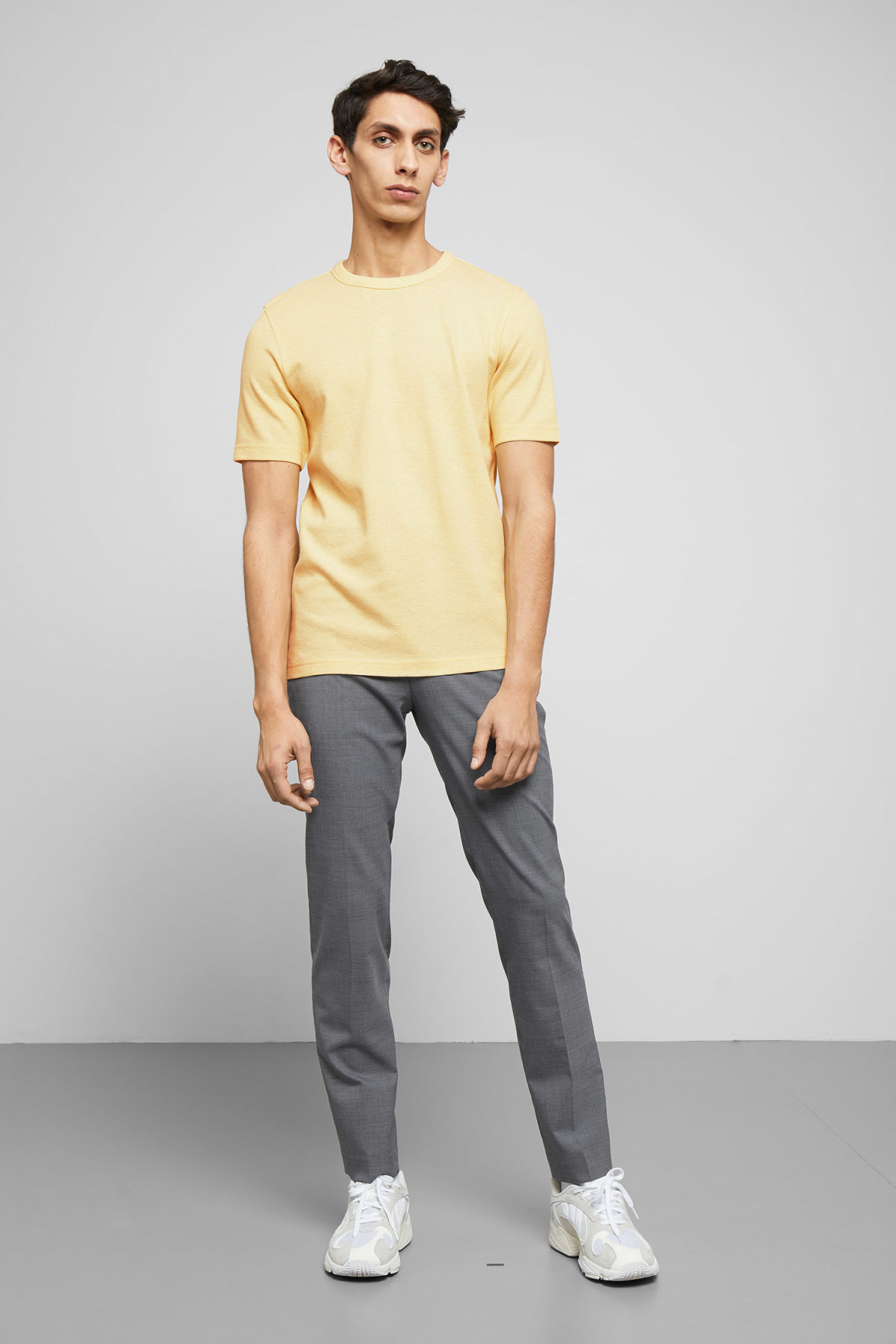 Model side image of Weekday grinko t-shirt in yellow