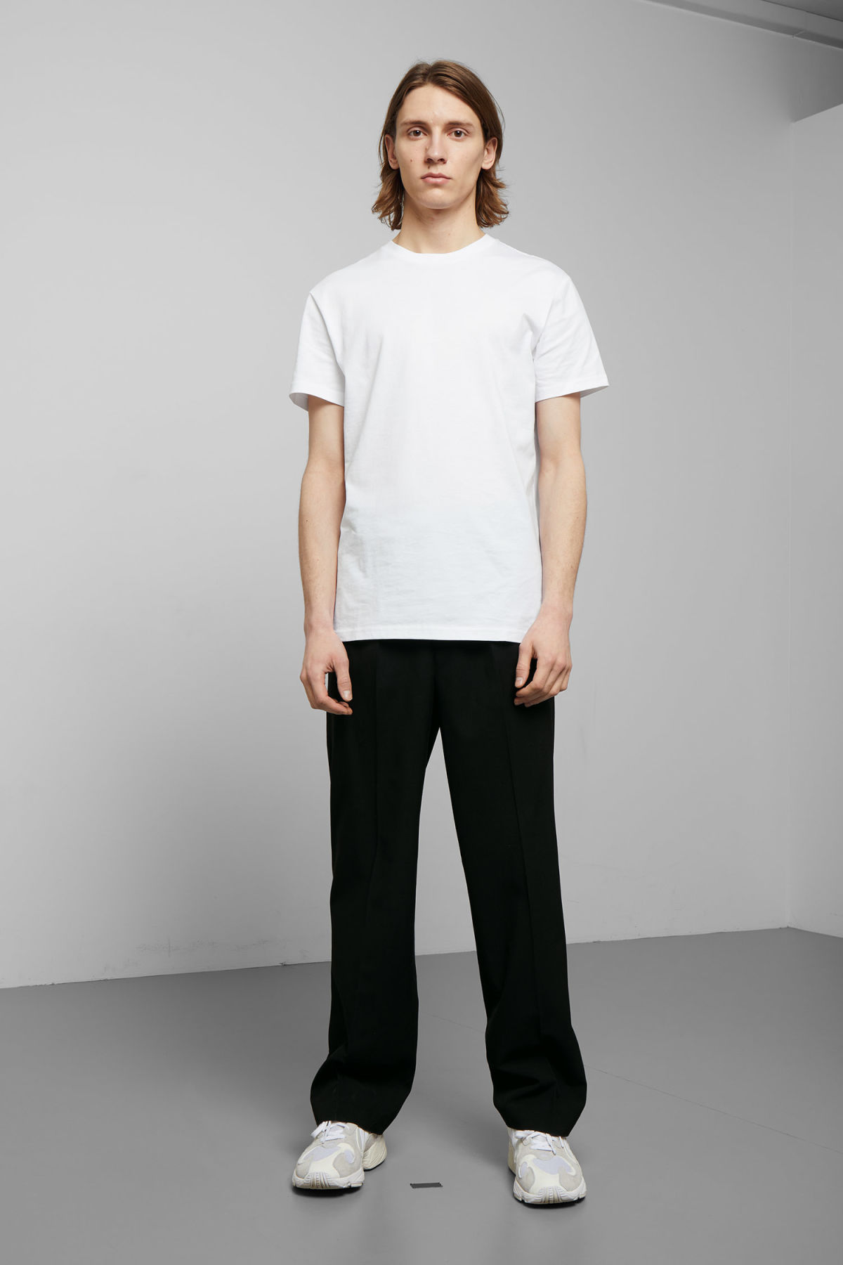 Model side image of Weekday alan t-shirt in white