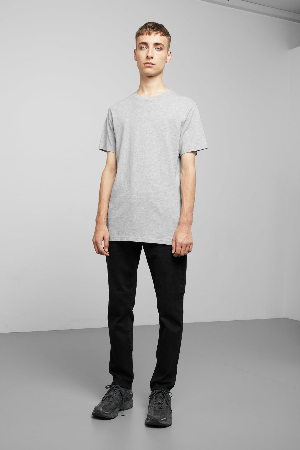Model side image of Weekday alan t-shirt in grey